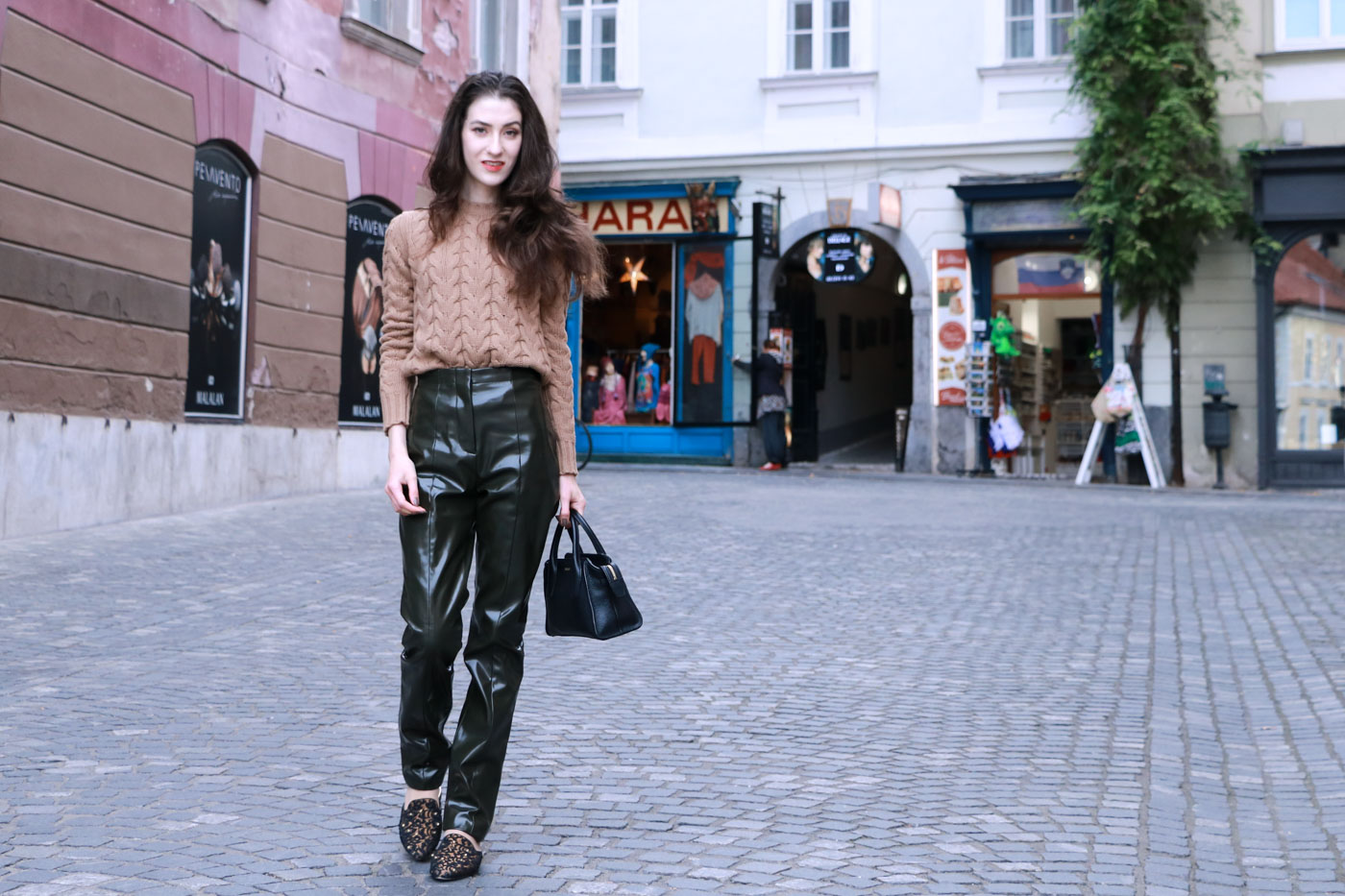 Fashion Blogger Veronika Lipar of Brunette from Wall Street wearing high-shine vinyl Acne Studios pants and camel Max Mara sweater