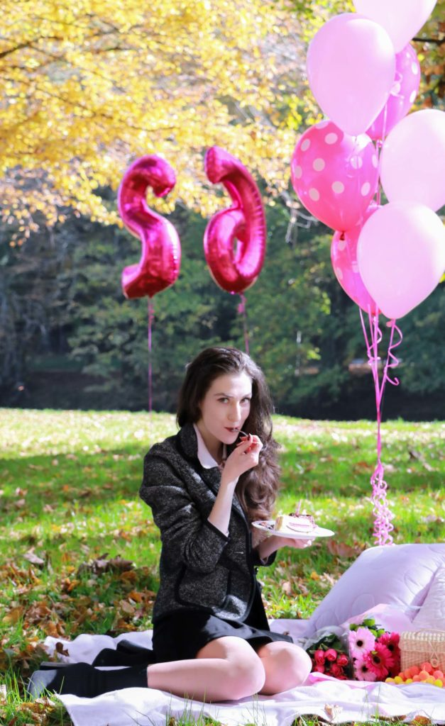 Fashion Blogger Veronika Lipar of Brunette from Wall Street eating her birthday cake