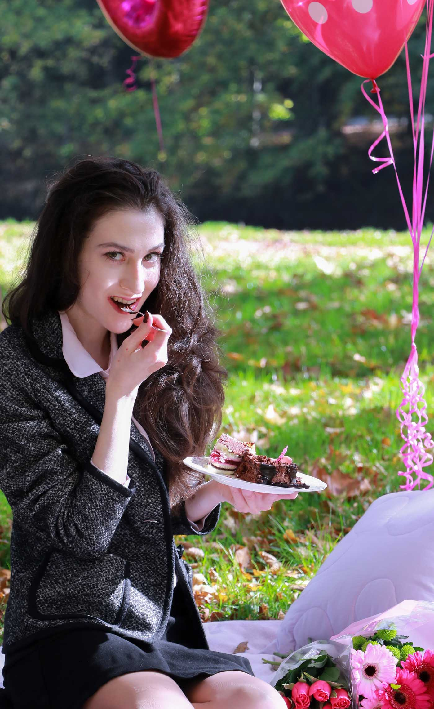 Fashion Blogger Veronika Lipar of Brunette from Wall Street wearing chic mini ruffled skirt, tweed jacket, romantic ruffled pink blouse and sock ankle boots at her birthday picnic