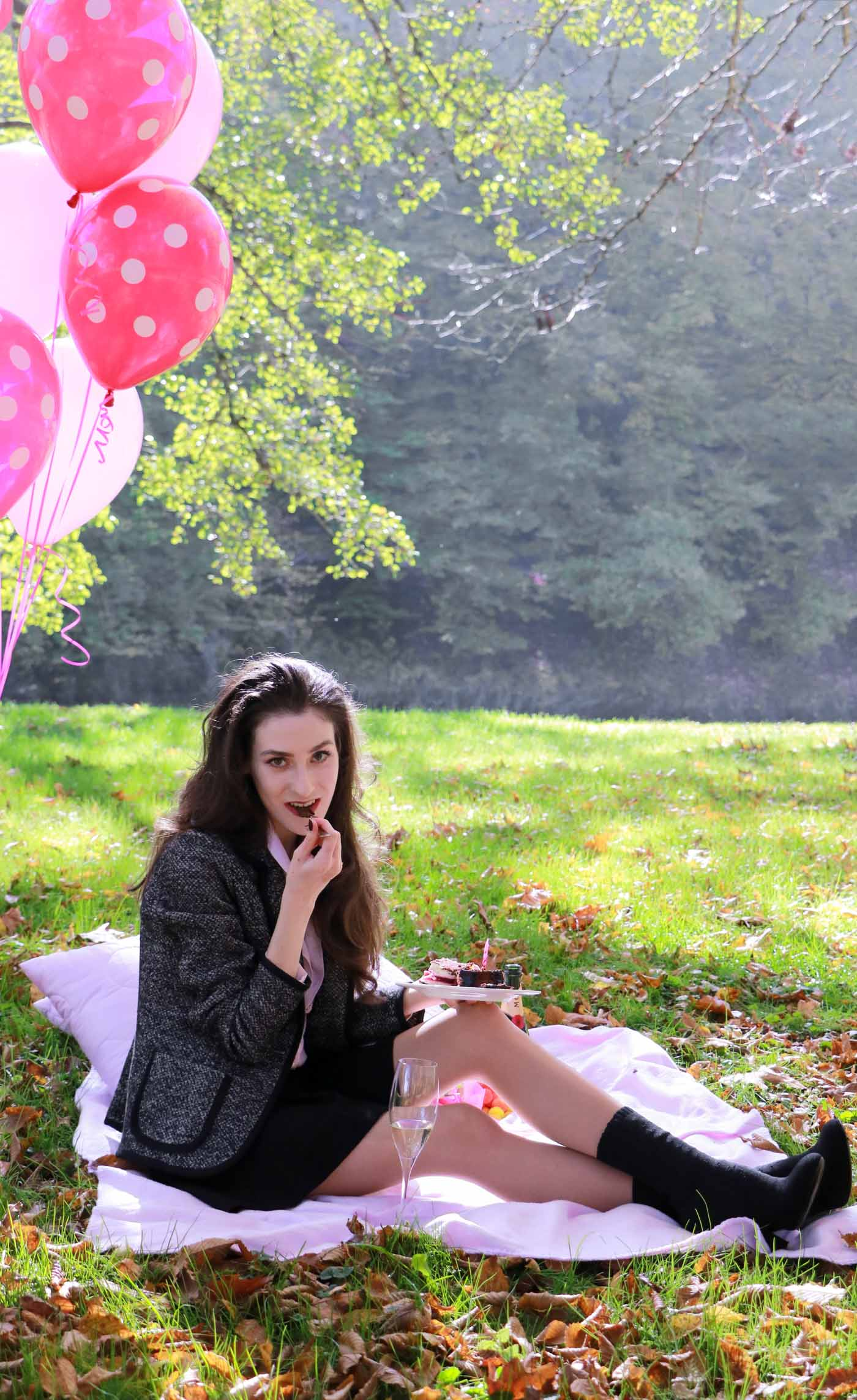 Fashion Blogger Veronika Lipar of Brunette from Wall Street wearing chic mini ruffled skirt, tweed jacket, romantic ruffled pink blouse and sock booties at her outdoor birthday party