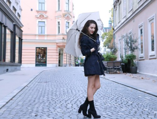 Fashion Blogger Veronika Lipar of Brunette from Wall Street dressed in blue trench coat and black sock booties this autumn when rains