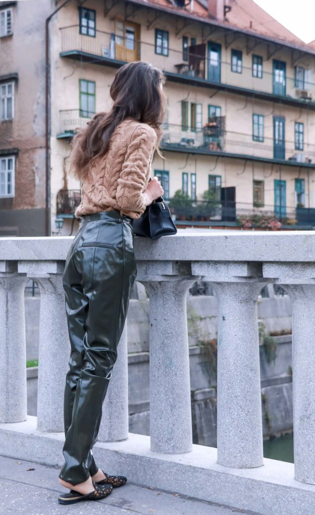 Fashion Blogger Veronika Lipar of Brunette from Wall Street on how to wear vinyl pants and simple camel cable knit sweater