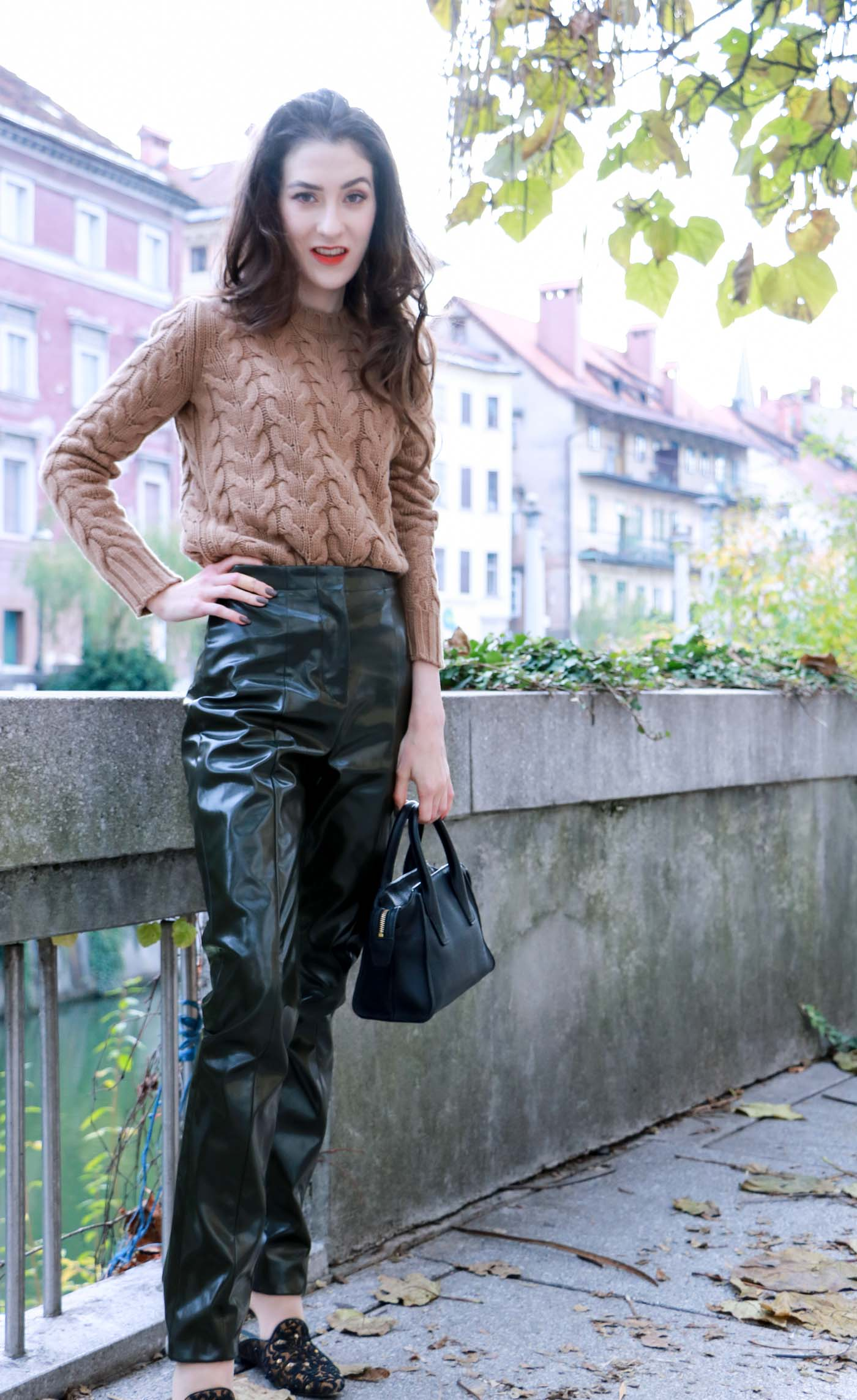 Fashion Blogger Veronika Lipar of Brunette from Wall Street on how to wear streight-leg high-shine vinyl pants and cashmere and wool cable knit sweater