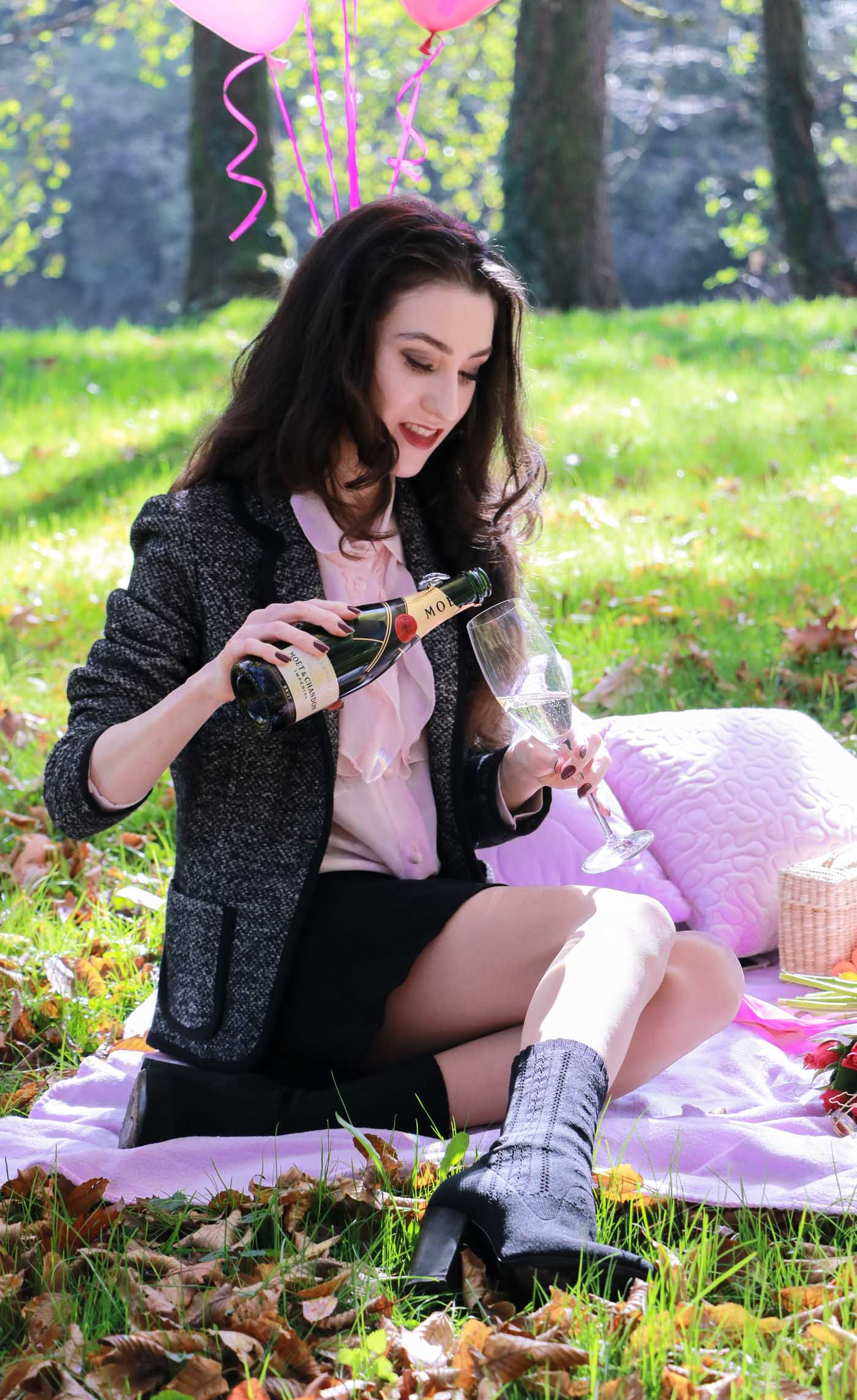 Fashion Blogger Veronika Lipar of Brunette from Wall Street pouring champagne