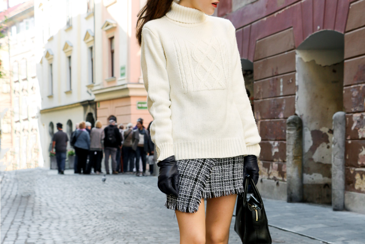 Fashion Blogger Veronika Lipar of Brunette from Wall Street on how to wear oversized knits to look sexy this autumn