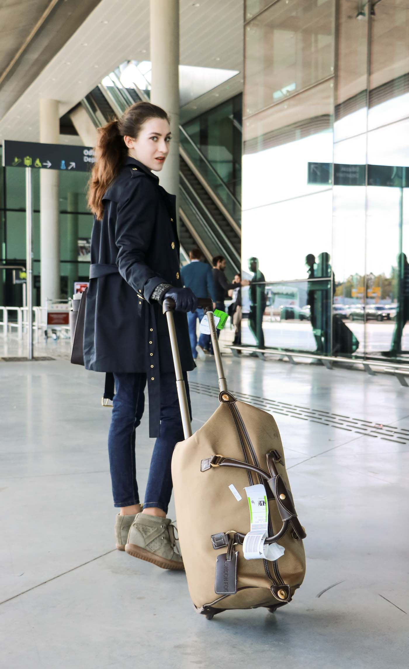 Fashion Blogger Veronika Lipar of Brunette from Wall Street at the airport