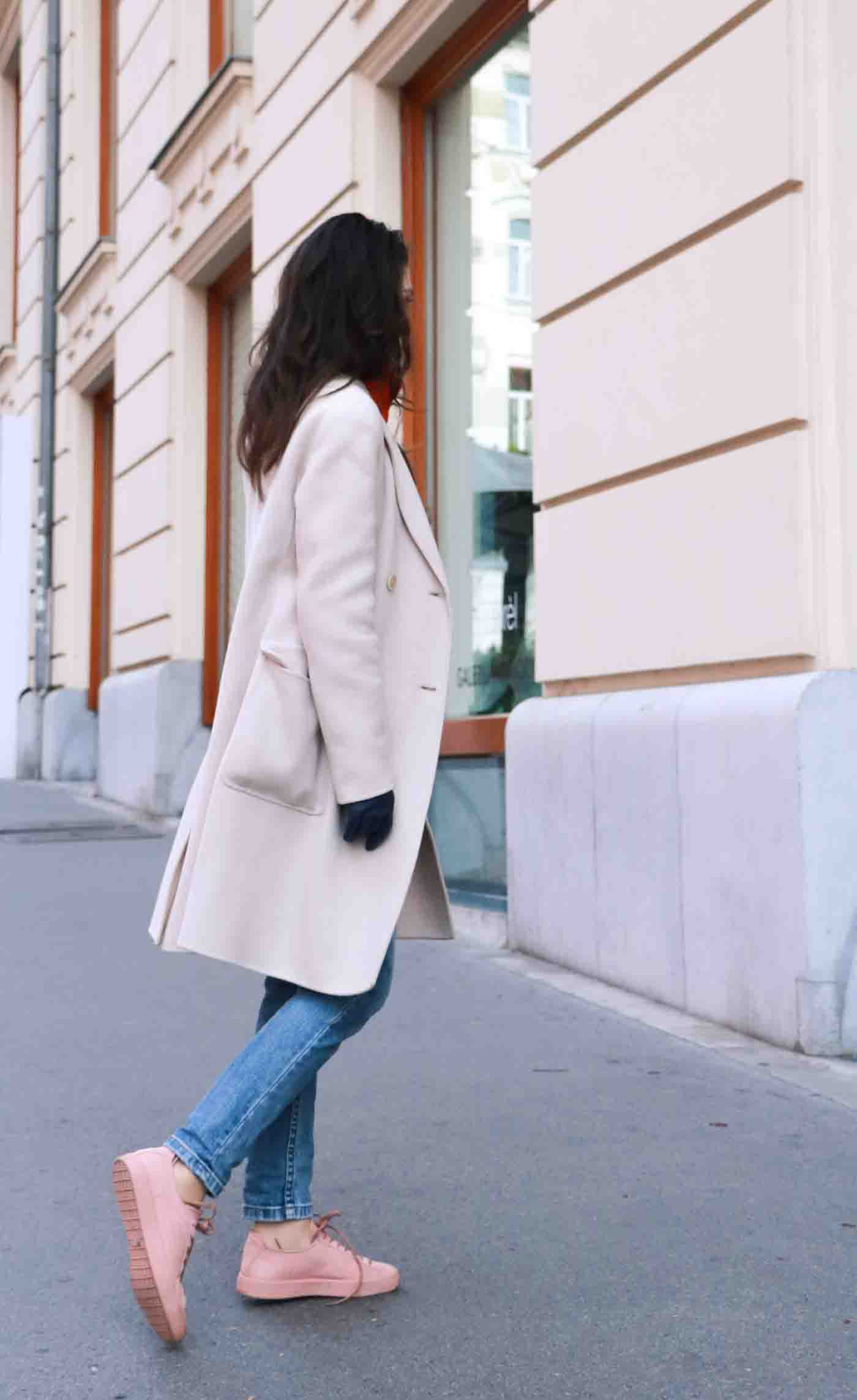 Fashion Blogger Veronika Lipar of Brunette from Wall wearing light blue jeans, dusty pink sneakers and Weekend Maxmara double breasted coat