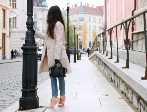 Fashion Blogger Veronika Lipar of Brunette from Wall wearing blue mom jeans, millennium pink sneakers and Weekend Maxmara white princess coat