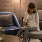 Veronika Lipar Fashion Blogger of Brunette from Wall Street wearing white cardigan with houndstooth wool pants for Thanksgiving Day Dinner at home
