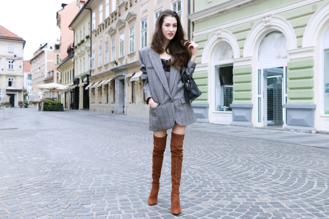 Fashion Blogger Veronika Lipar of Brunette from Wall wearing brown Stuart Weitzman highland boots, and oversized boyfriend blazer like a dress