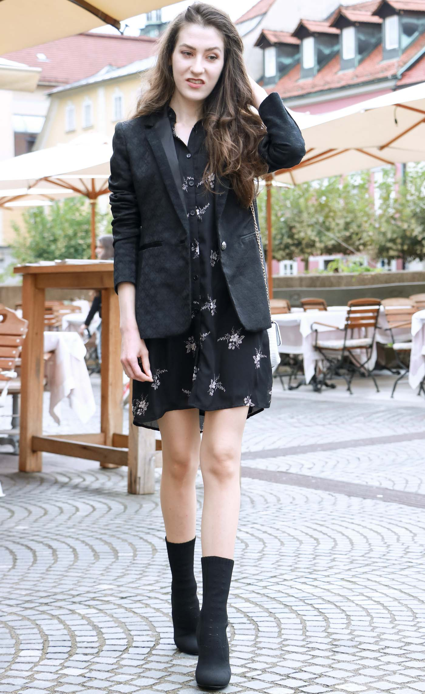 Fashion Blogger Veronika Lipar of Brunette from Wall wearing dark floral shirt dress, black jacquard boyfriend blazer, black sock ankle boots, white shoulder bag