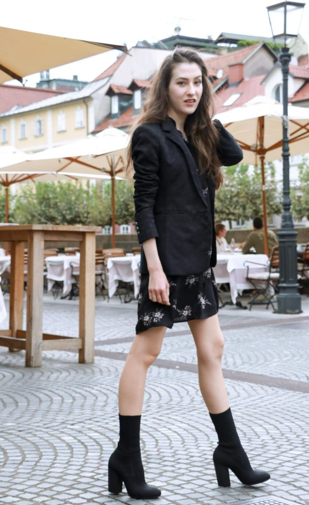 Fashion Blogger Veronika Lipar of Brunette from Wall dressed in dark floral shirt dress, black jacquard boyfriend blazer, black sock booties, white shoulder bag
