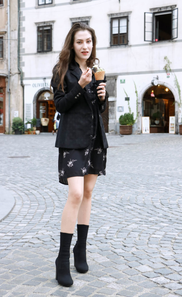 Fashion Blogger Veronika Lipar of Brunette from Wall wearing chic Friday outfit eating ice cream on the street