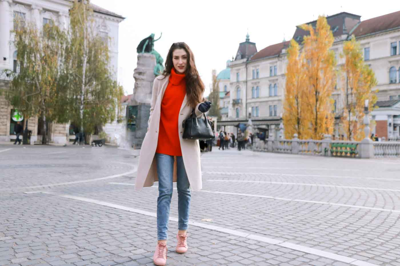 Fashion Blogger Veronika Lipar of Brunette from Wall wearing red Ganni turtleneck sweater, blue mom jeans, millennium pink sneakers and Weekend Maxmara white double-breasted coat