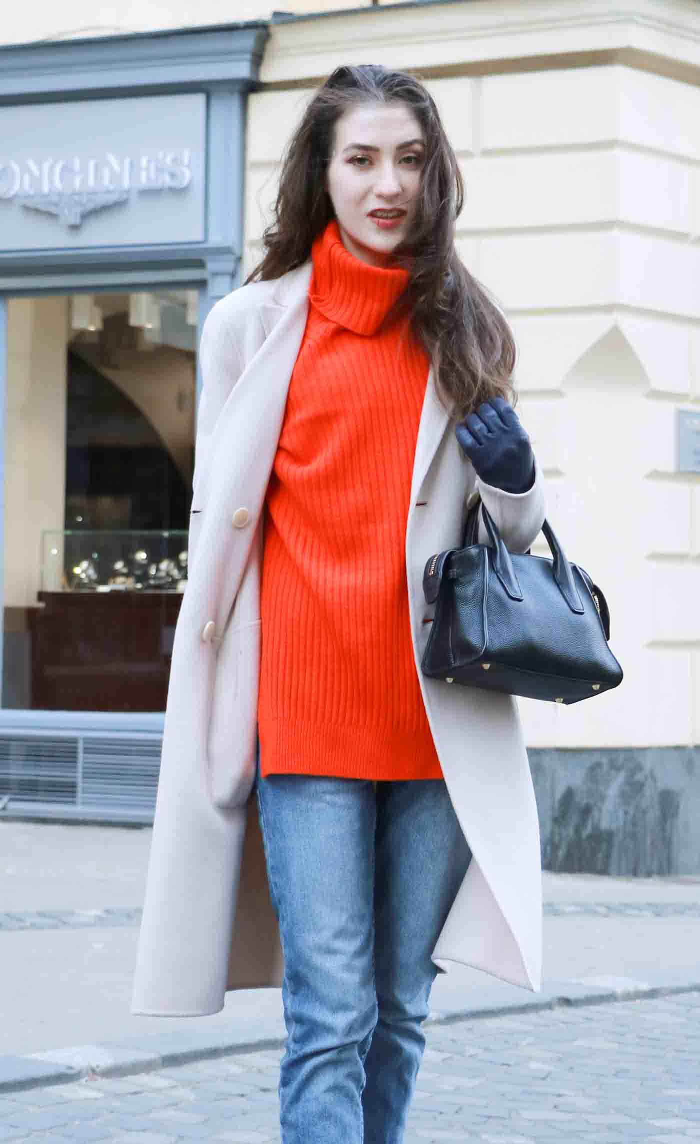 Fashion Blogger Veronika Lipar of Brunette from Wall wearing red Ganni turtleneck sweater, light blue jeans, and Weekend Maxmara beige princess coat