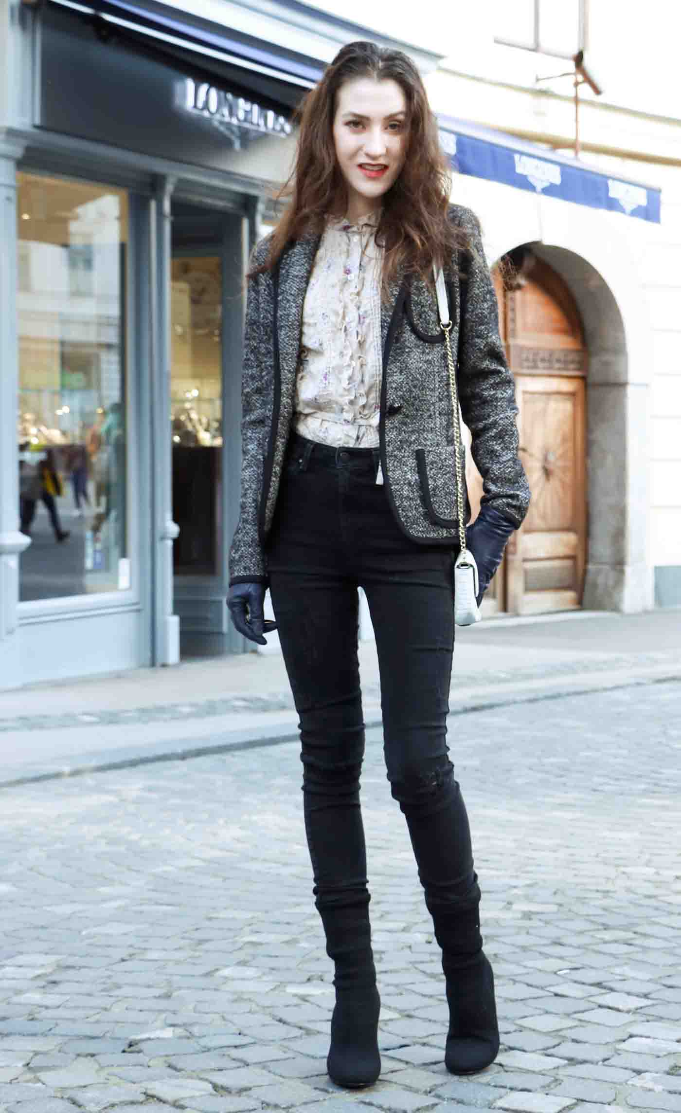 Fashion Blogger Veronika Lipar of Brunette from Wall wearing distressed black skinny jeans, black sock boots and floral high collar blouse under tweed black and white blazer