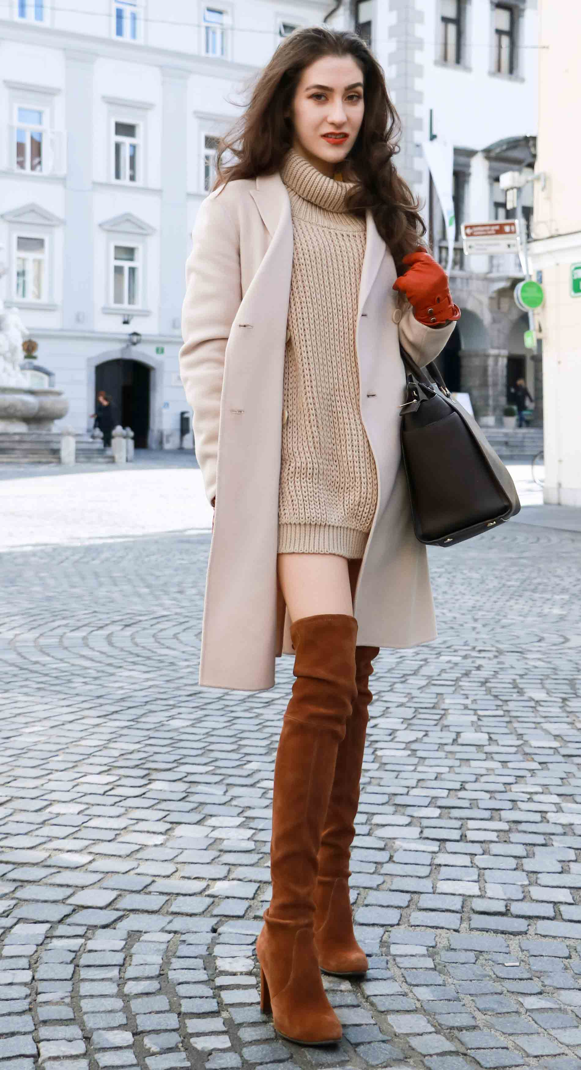Fashion Blogger Veronika Lipar of Brunette from Wall wearing double breasted coat, cable knit turtleneck camel sweater dress and brown Stuart Weitzman over the knee boots, brown Michael Kors Selma bag, leather gloves