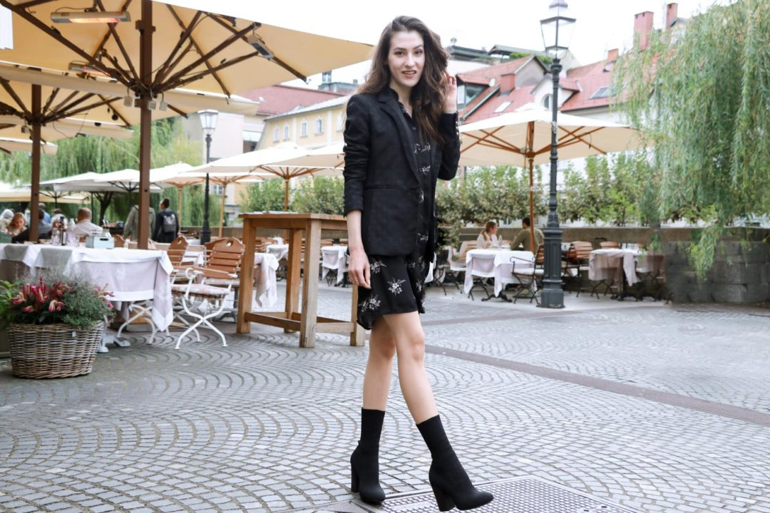 Fashion Blogger Veronika Lipar of Brunette from Wall dressed in dark floral shirt dress, black jacquard boyfriend blazer, black sock ankle boots, white shoulder bag