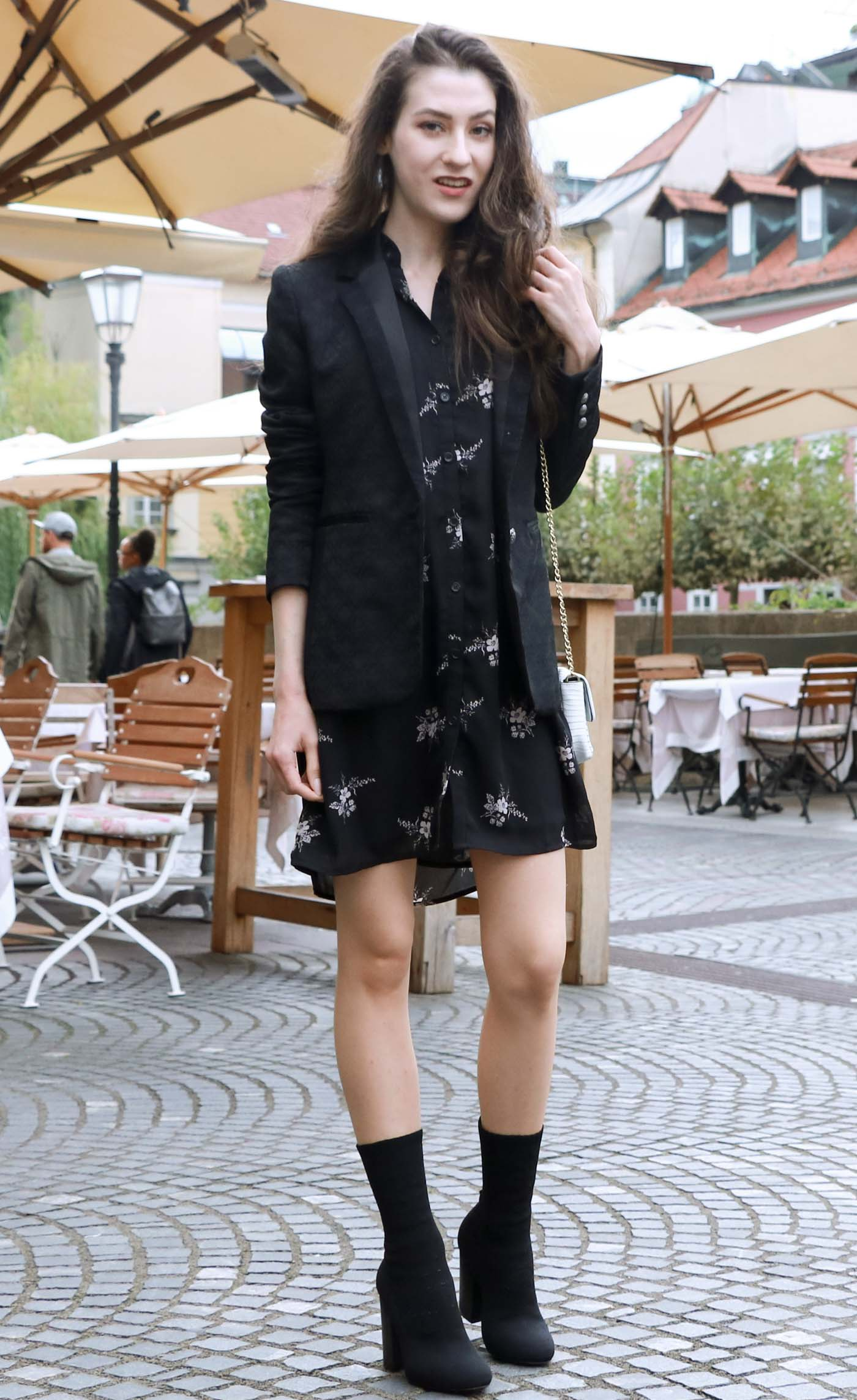 Fashion Blogger Veronika Lipar of Brunette from Wall wearing dark floral shirt dress, black jacquard boyfriend blazer, black sock booties, white shoulder bag