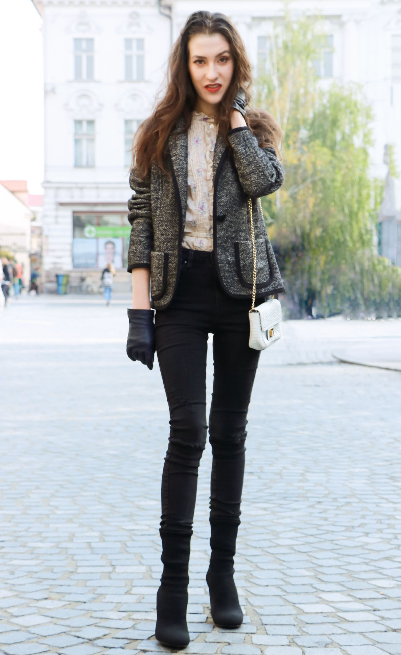 Fashion Blogger Veronika Lipar of Brunette from Wall wearing black skinny jeans, black sock ankle boots and statement blouse under tweed black and white blazer