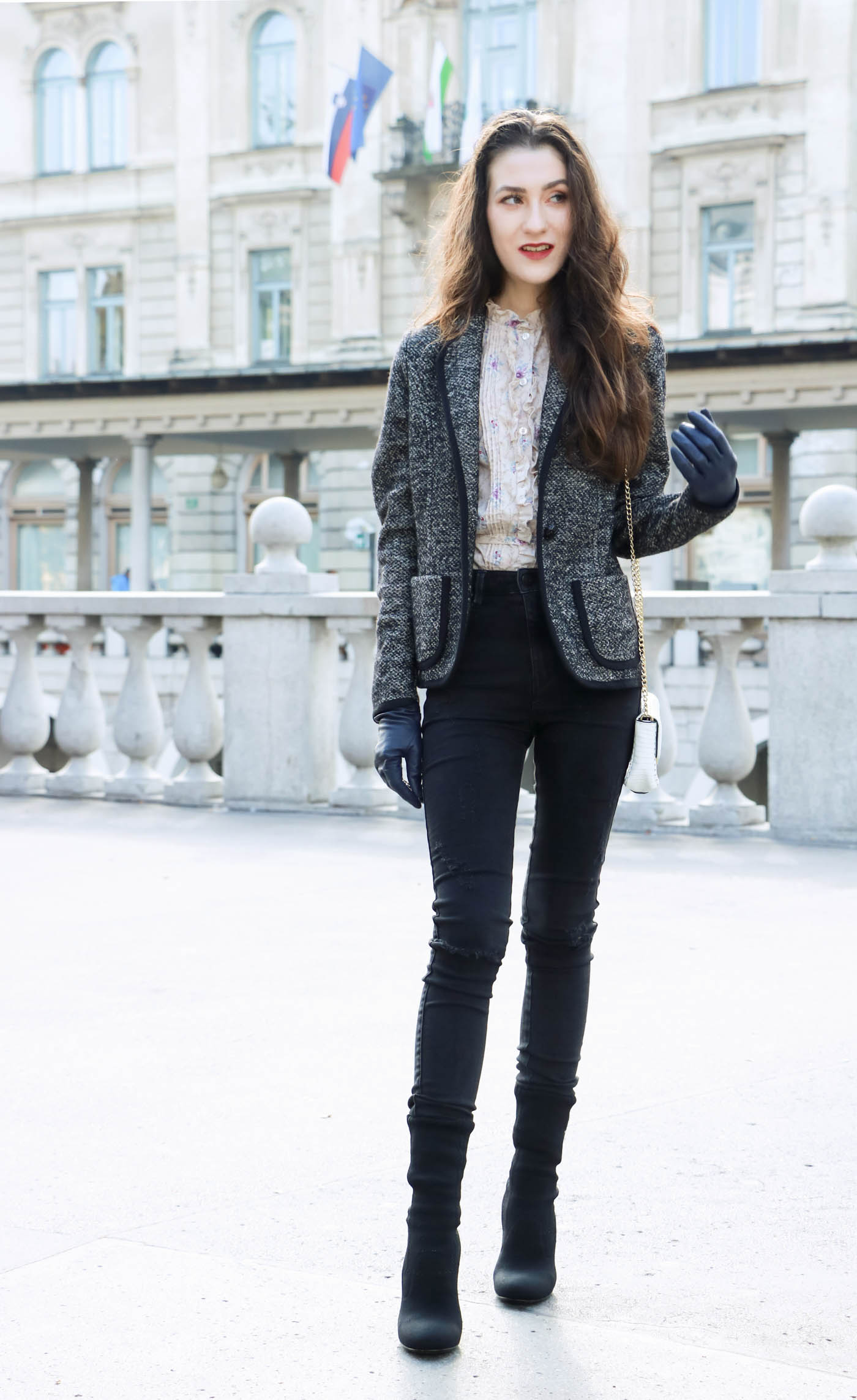 Fashion Blogger Veronika Lipar of Brunette from Wall wearing black skinny jeans, black sock ankle boots and party blouse under tweed black and white blazer