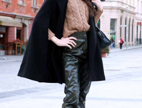 Fashion Blogger Veronika Lipar of Brunette from Wall wearing green Acne Studios high shine vinyl pants, and black cape for work