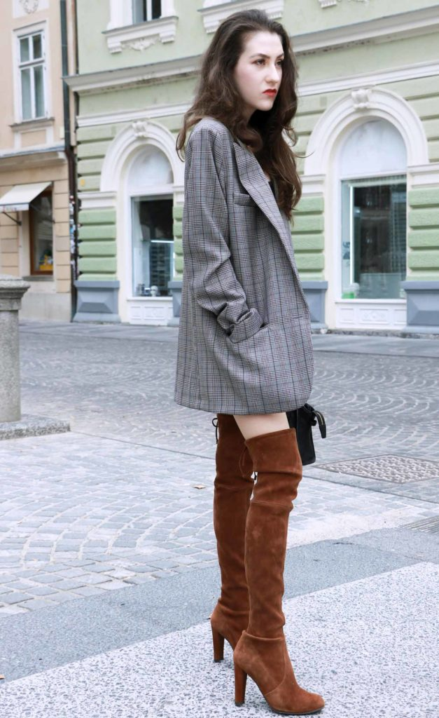 Fashion Blogger Veronika Lipar of Brunette from Wall wearing brown Stuart Weitzman otk boots, and oversized boyfriend blazer like a dress