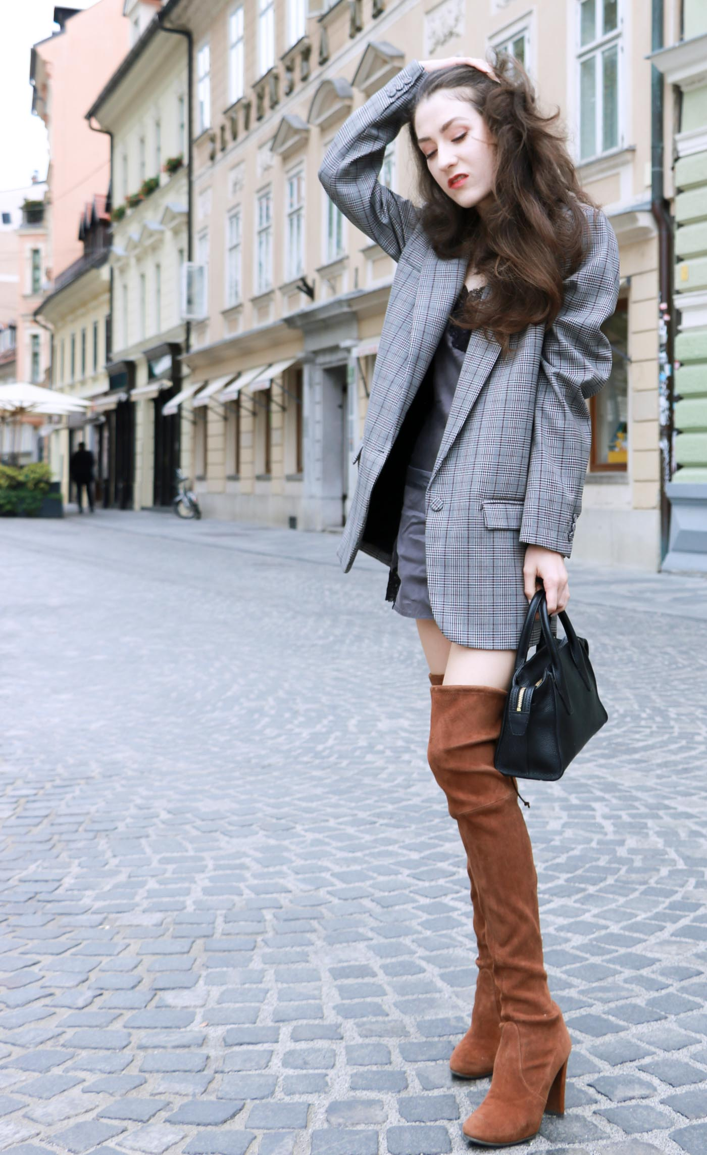Fashion Blogger Veronika Lipar of Brunette from Wall wearing brown Stuart Weitzman highland boots, and oversized boyfriend blazer as a dress