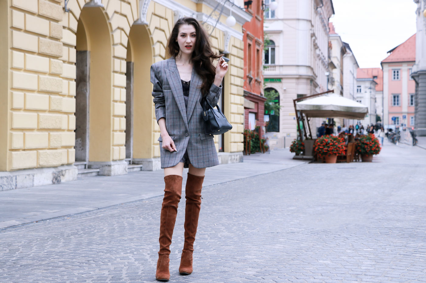Fashion Blogger Veronika Lipar of Brunette from Wall wearing brown Stuart Weitzman otk boots, and wool checked oversized boyfriend blazer