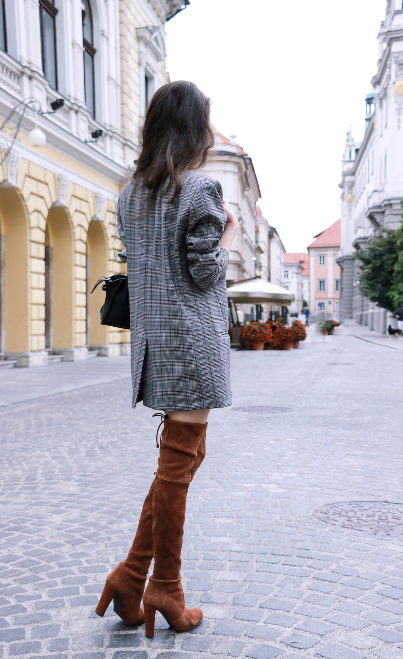 Fashion Blogger Veronika Lipar of Brunette from Wall wearing brown Stuart Weitzman otk boots, and oversized boyfriend blazer as a dress