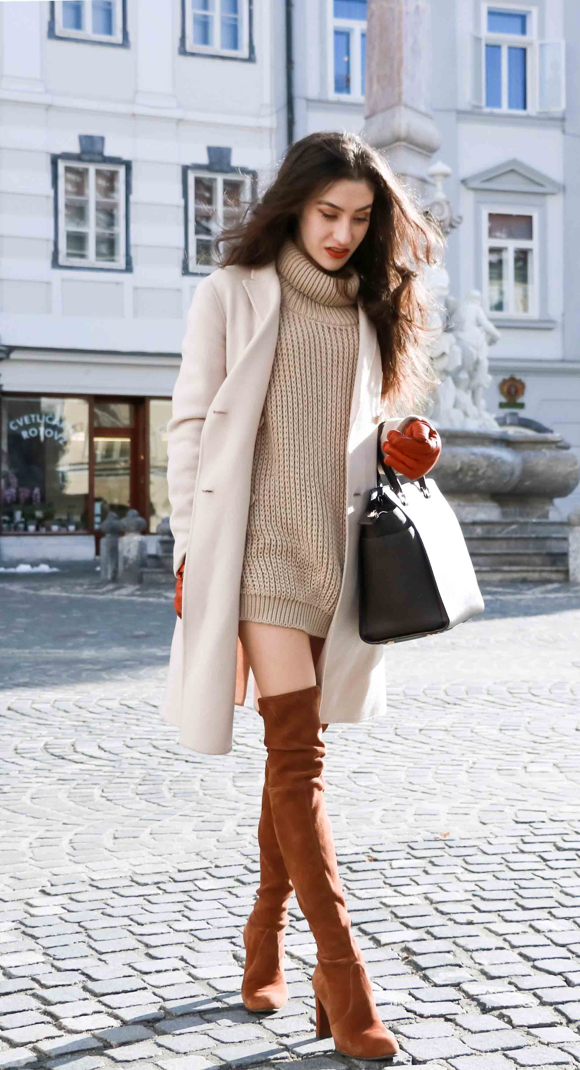 Fashion Blogger Veronika Lipar of Brunette from Wall wearing double breasted coat, cable knit turtleneck camel sweater dress and Stuart Weitzman over the knee boots, brown Michael Kors Selma bag, leather gloves