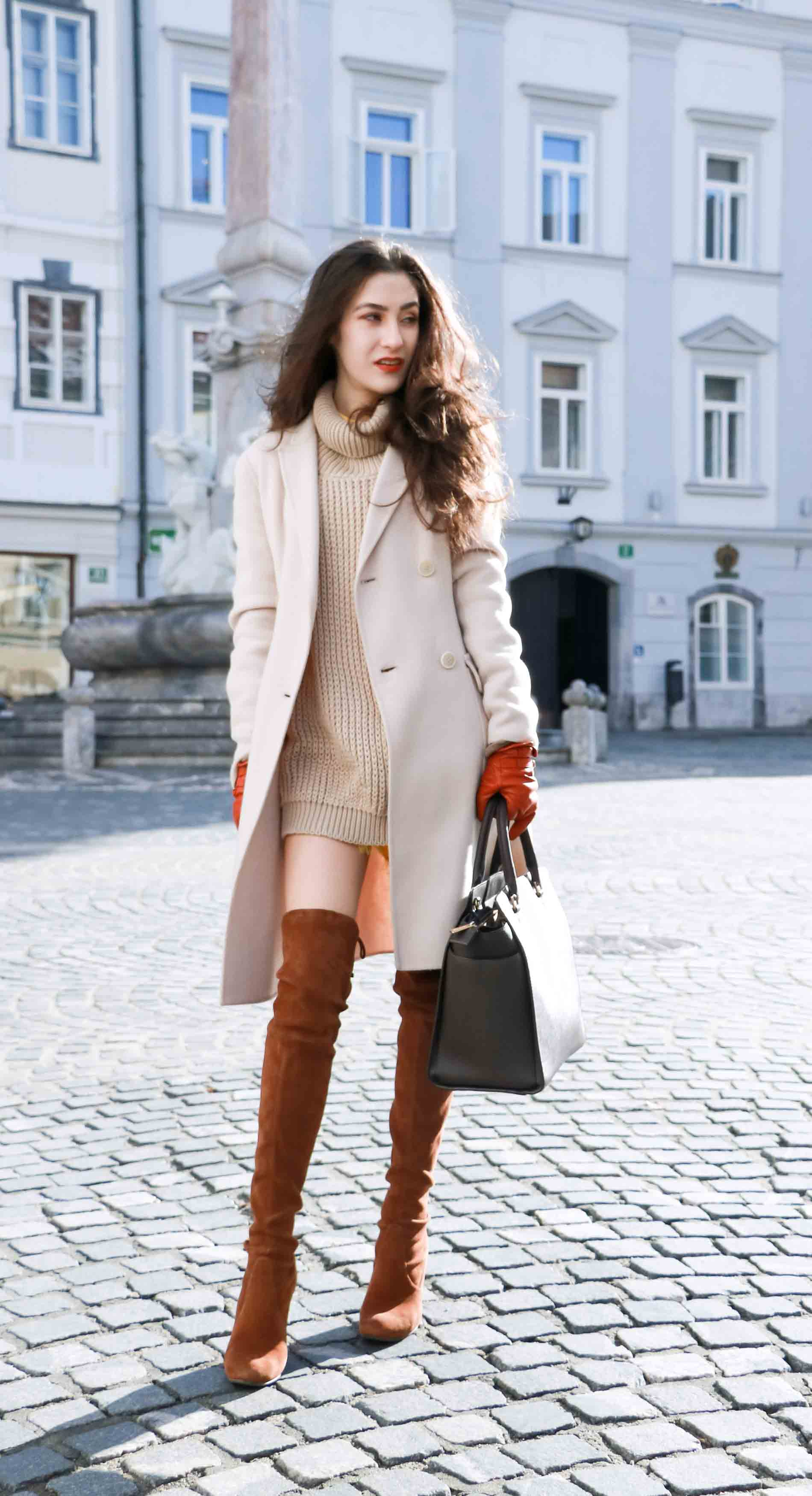Fashion Blogger Veronika Lipar of Brunette from Wall dressed in double breasted coat, cable knit turtleneck camel sweater dress and Stuart Weitzman Highland boots, brown Michael Kors Selma bag, leather gloves