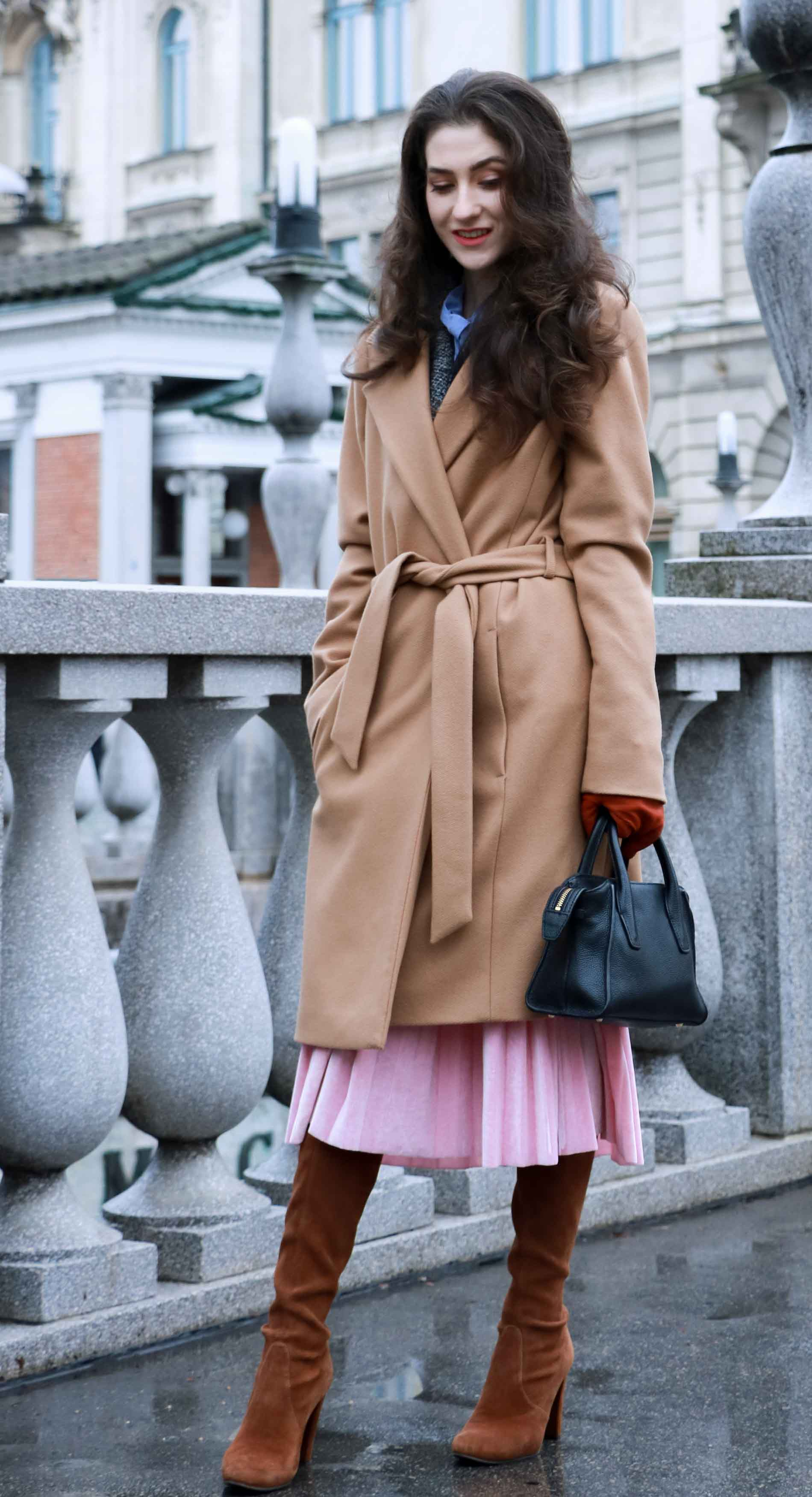 Fashion Blogger Veronika Lipar of Brunette from Wall Street wearing winter outfit, ESCADA wrap camel coat, pink velvet midi pleated skirt, brown Stuart Weitzman Highland over the knee boots, black top handle bag, leather gloves, when doing Christmas shopping