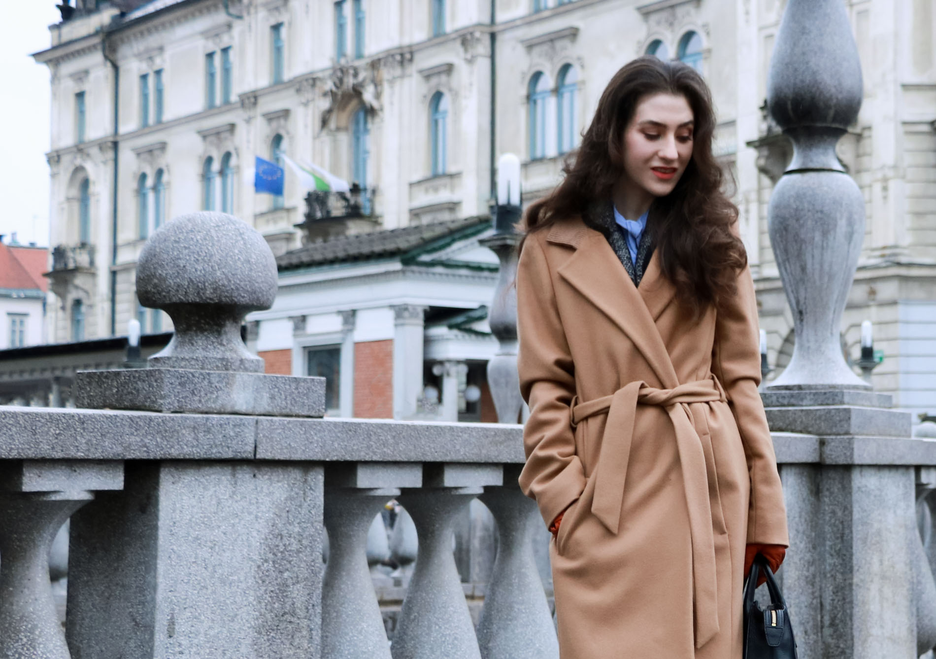 Fashion Blogger Veronika Lipar of Brunette from Wall Street wearing elegant outfit, ESCADA wrap camel coat