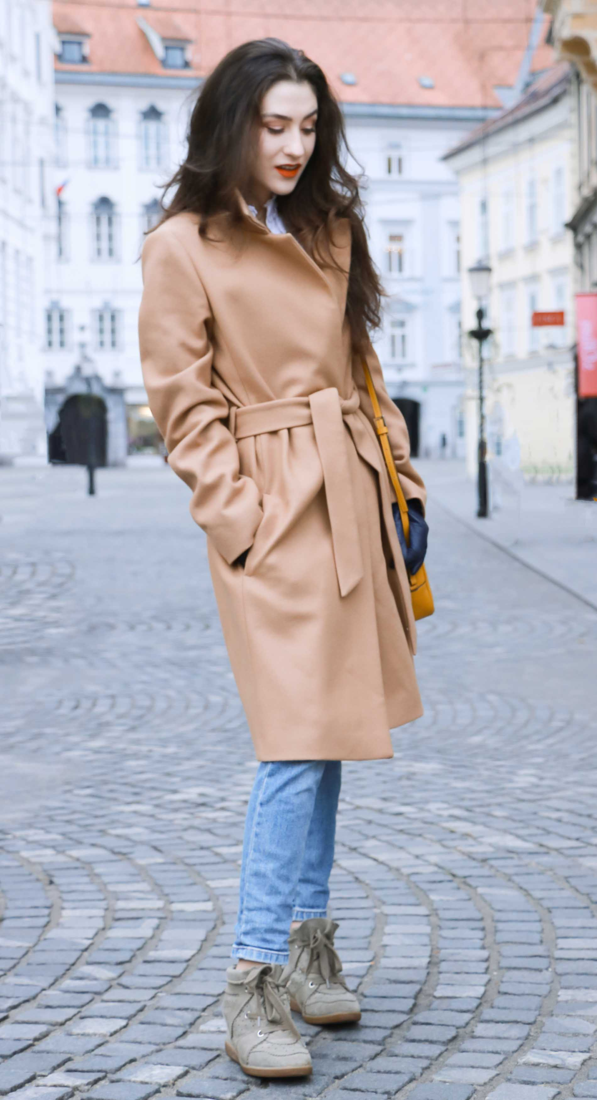 Fashion Blogger Veronika Lipar of Brunette from Wall Street sharing how she wears camel coat on Saturday