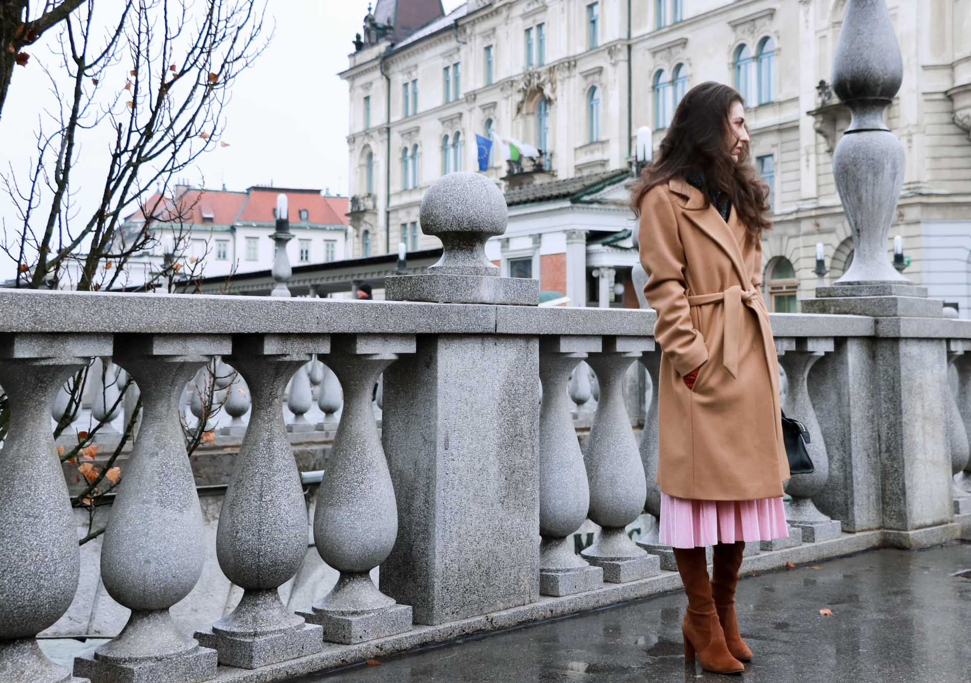 Fashion Blogger Veronika Lipar of Brunette from Wall Street sharing how she wears camel coat this winter and to Christmas brunch