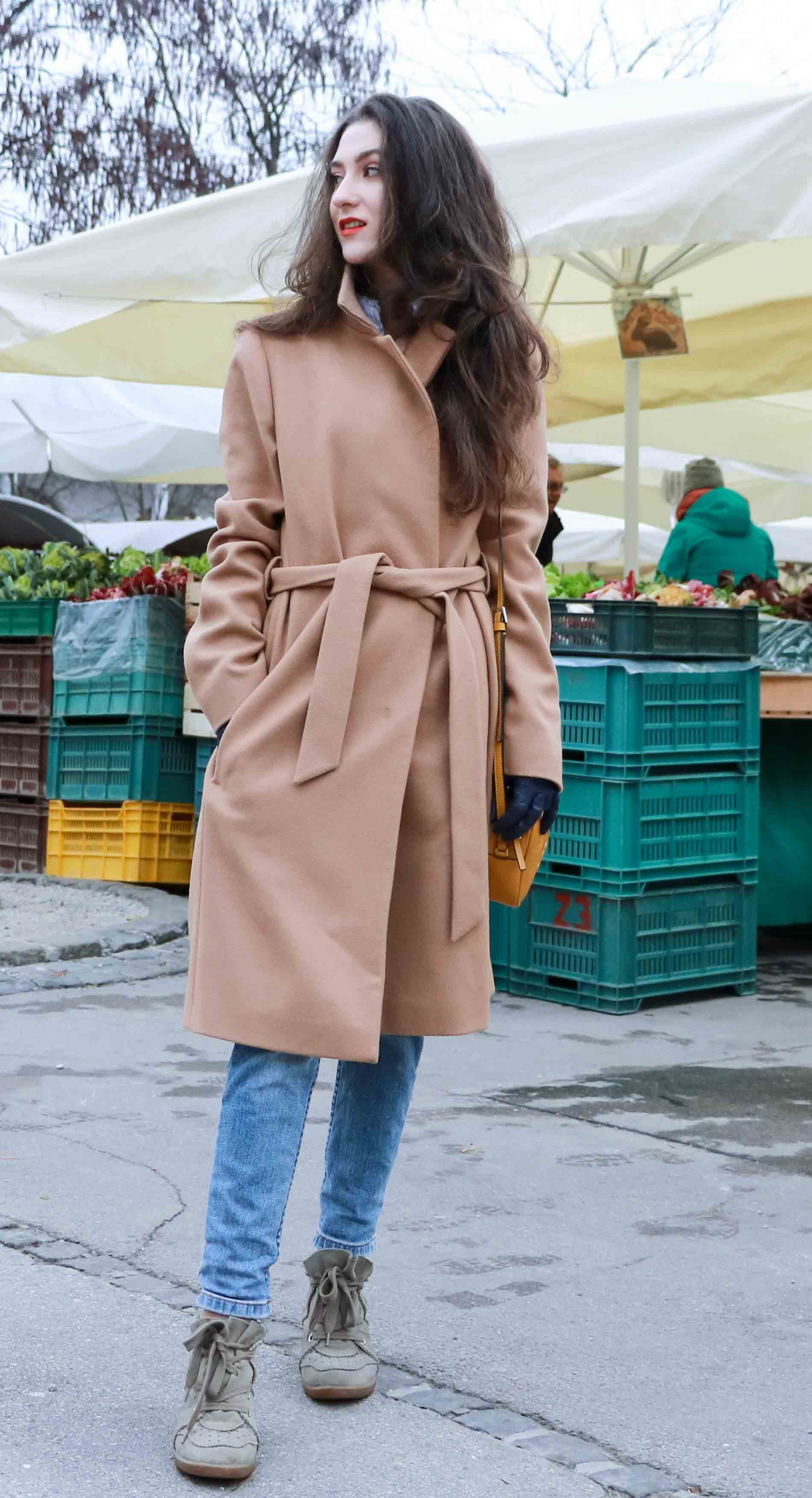 Fashion Blogger Veronika Lipar of Brunette from Wall Street wearing ESCADA wrap camel coat, A.P.C. blue jeans, Isabel Marant olive Bobby Sneakers, yellow shoulder bag from Escada, white Victorian blouse to the grocery's market