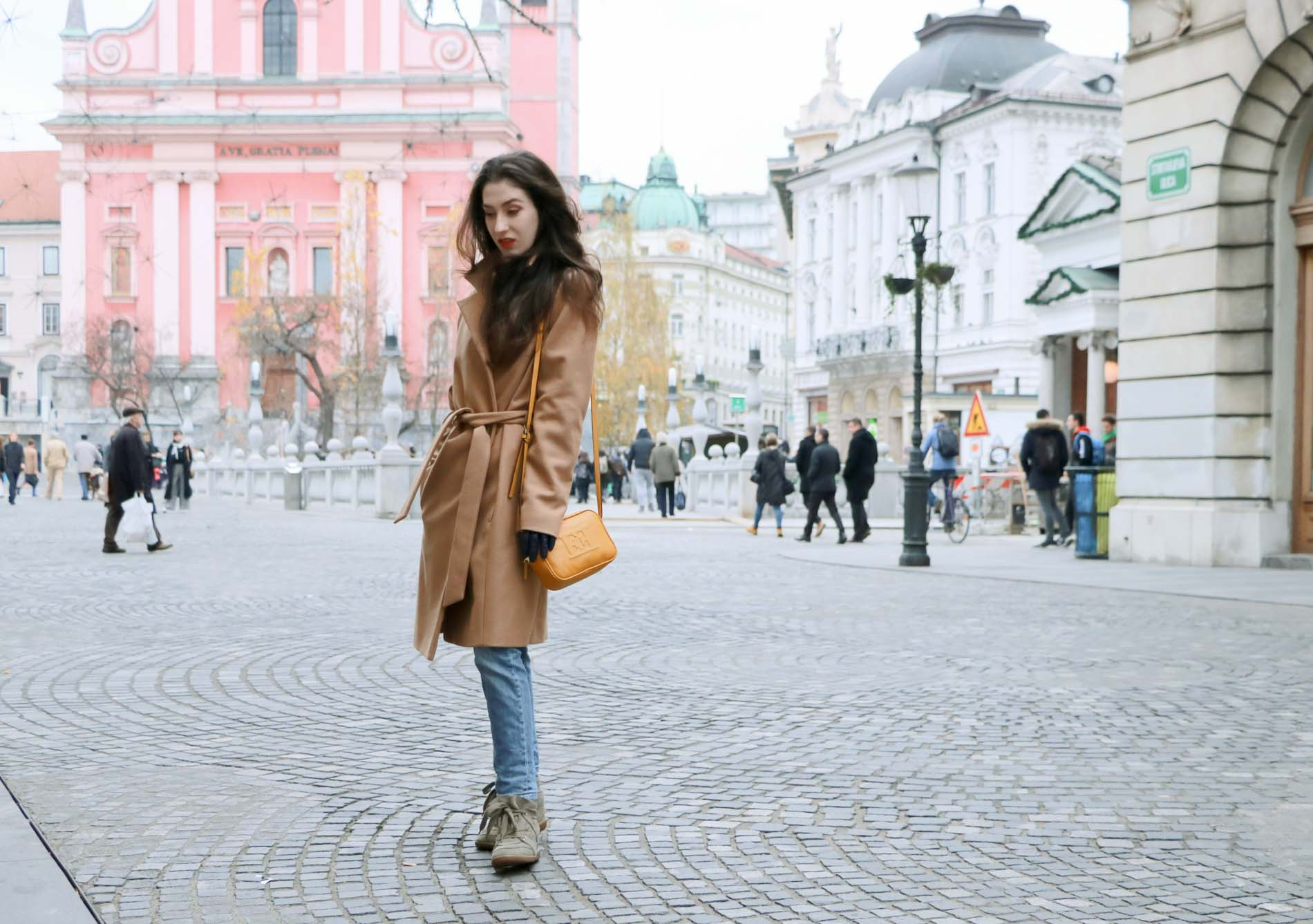 Fashion Blogger Veronika Lipar of Brunette from Wall Street on how to wear wrap wool camel coat