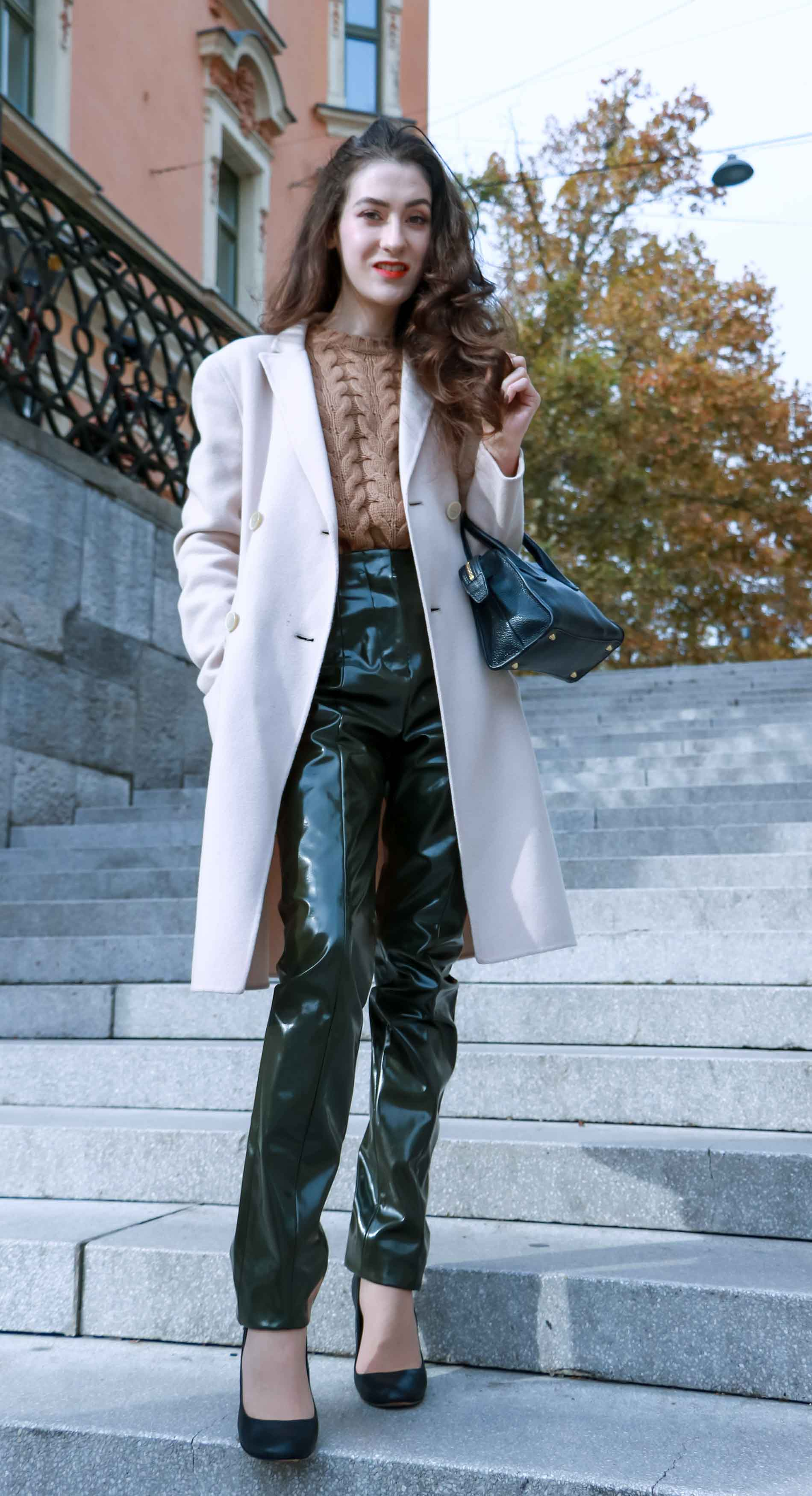 Fashion Blogger Veronika Lipar of Brunette from Wall Street wearing Acne Studios high-shine pants, Weekened Maxmara double breasted pastel coat, Max Mara camel cable knit sweater and black Aquazzura pumps as chic business outfit