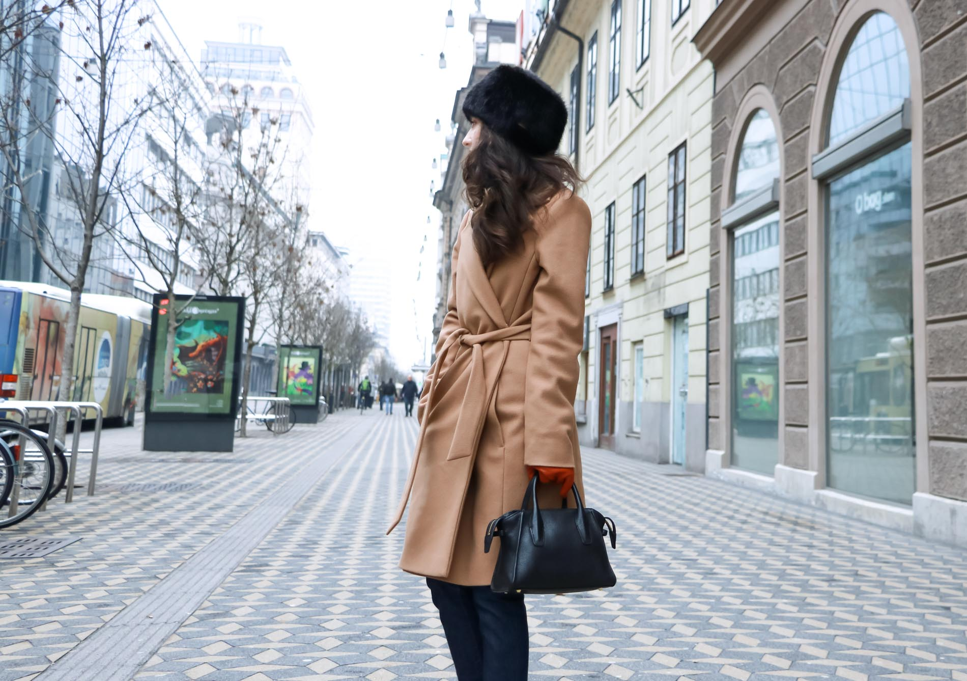 Fashion Blogger Veronika Lipar of Brunette from Wall Street wearing casual winter outfit you can put on in 5 minutes