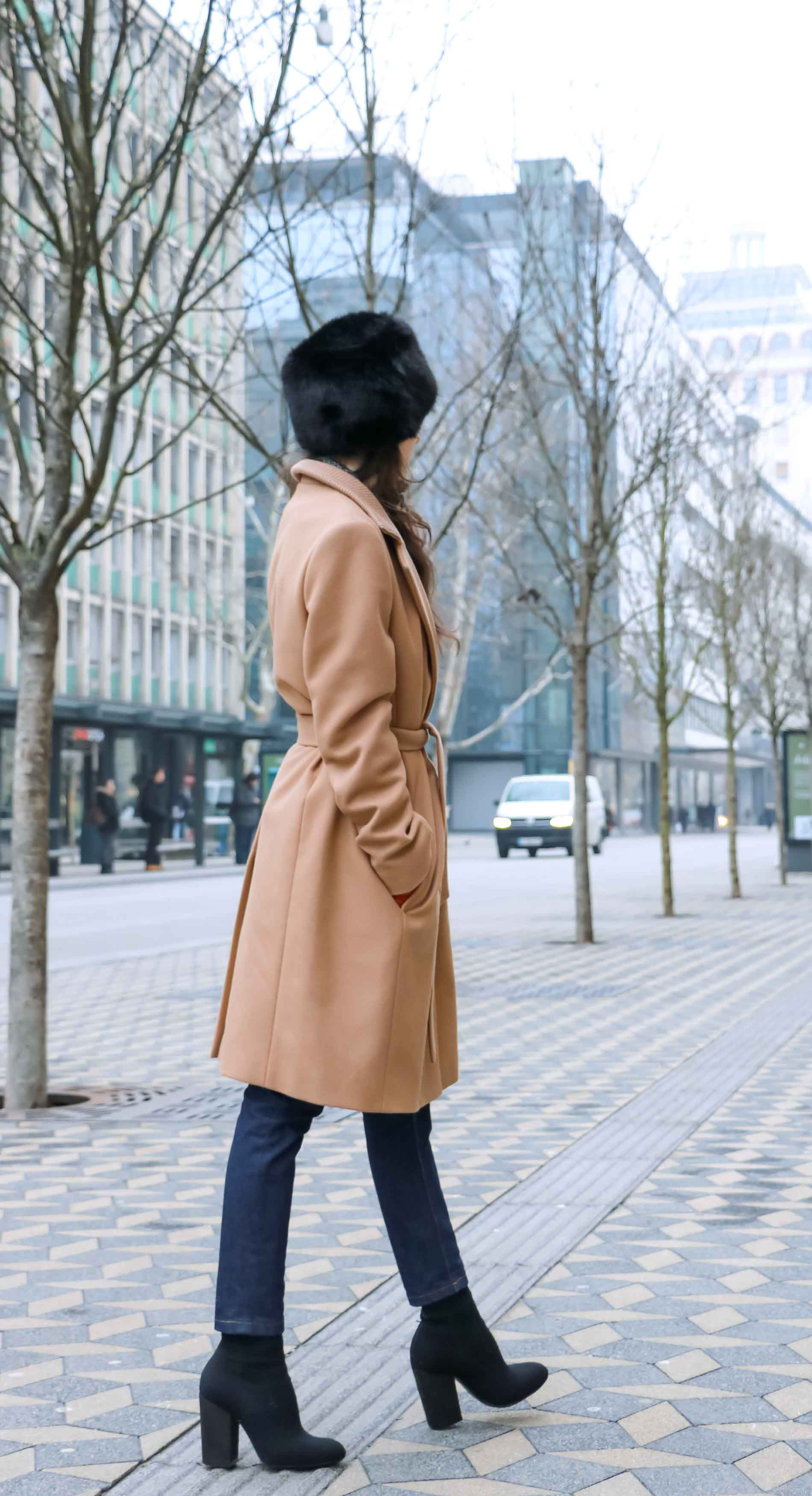 Fashion Blogger Veronika Lipar of Brunette from Wall Street dressed in her on the go winter outfit