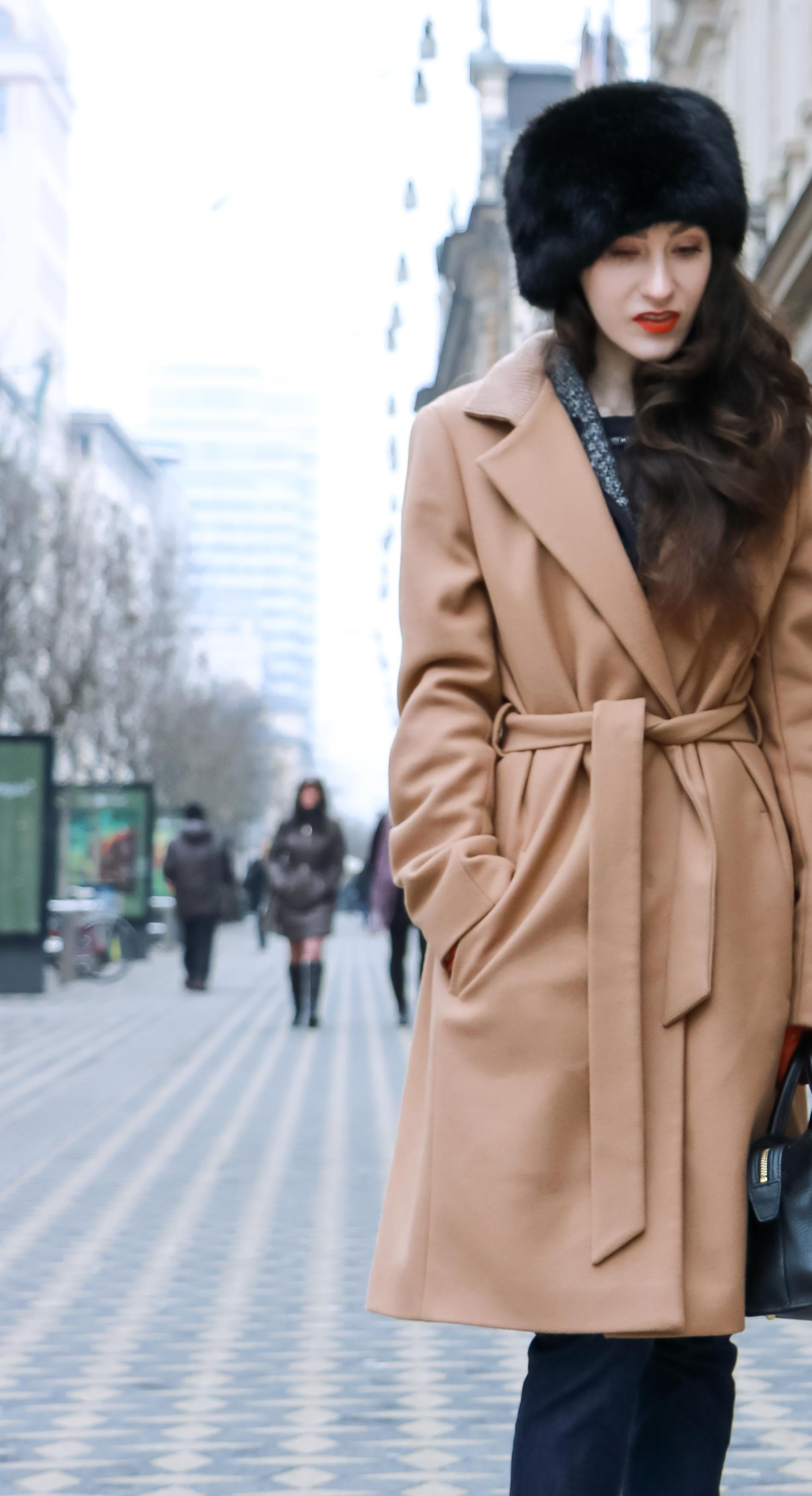 Fashion Blogger Veronika Lipar of Brunette from Wall Street wearing wrap Escada camel coat