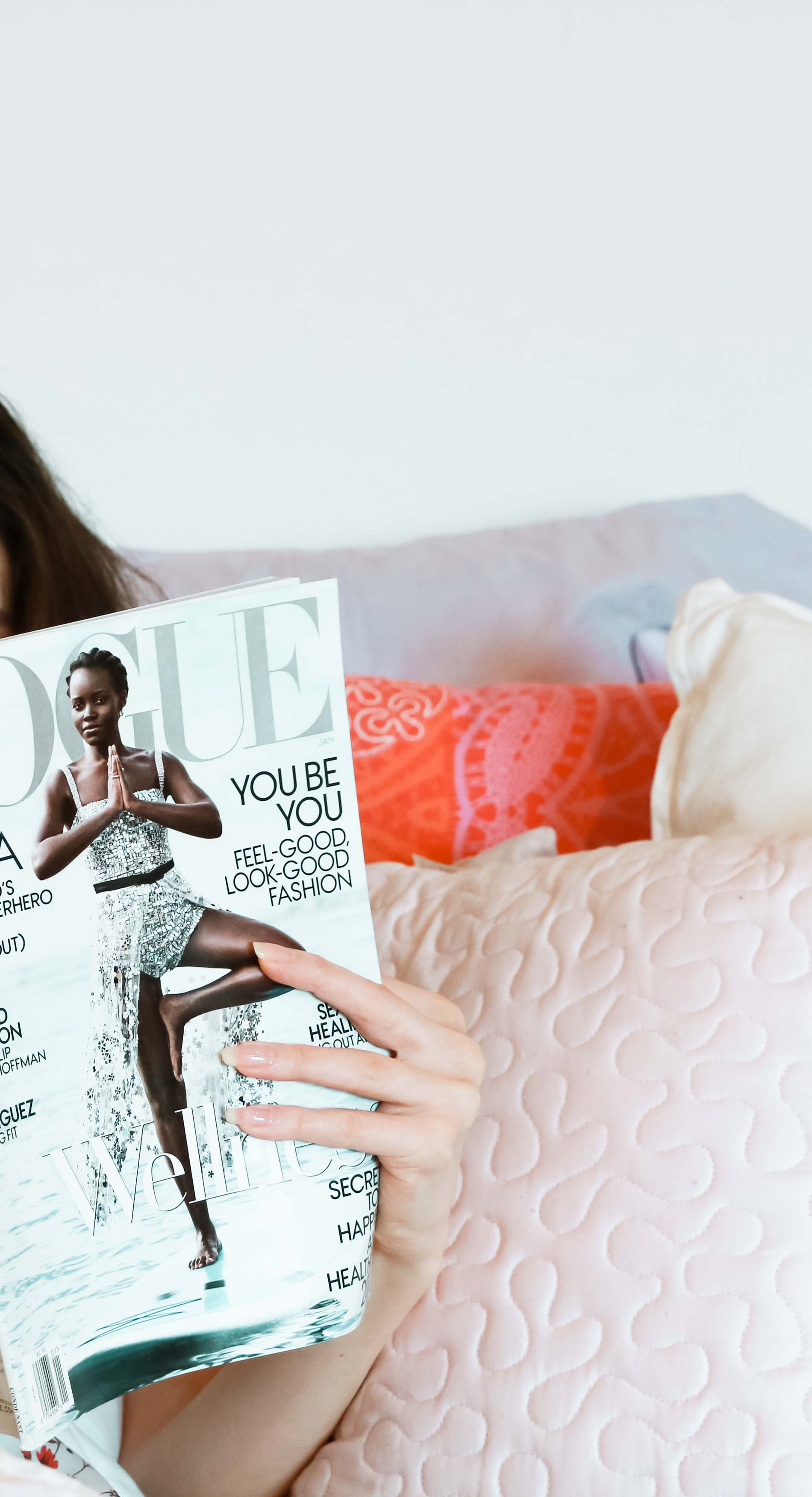Fashion Blogger Veronika Lipar of Brunette from Wall Street reading fashion magazine in bed