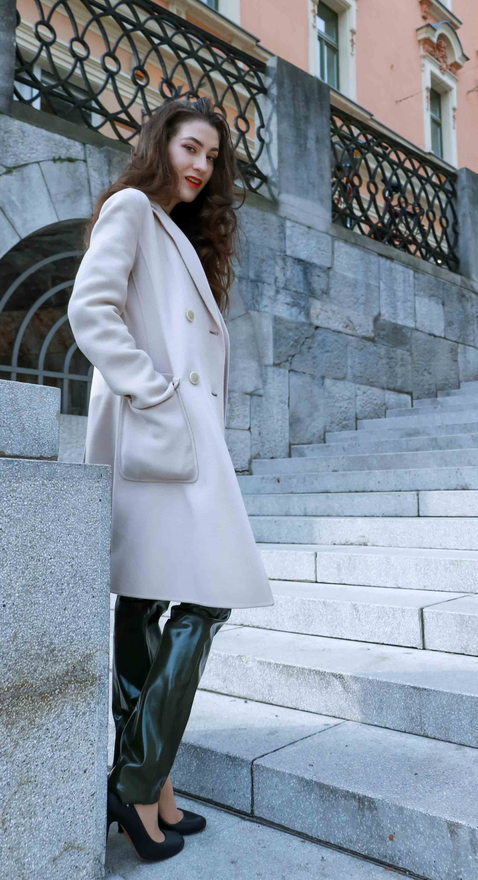 Fashion Blogger Veronika Lipar of Brunette from Wall Street wearing Acne Studios vinyl pants, Weekened Maxmara double breasted pastel coat, Max Mara camel cable knit sweater and black Aquazzura pumps as chic business outfit