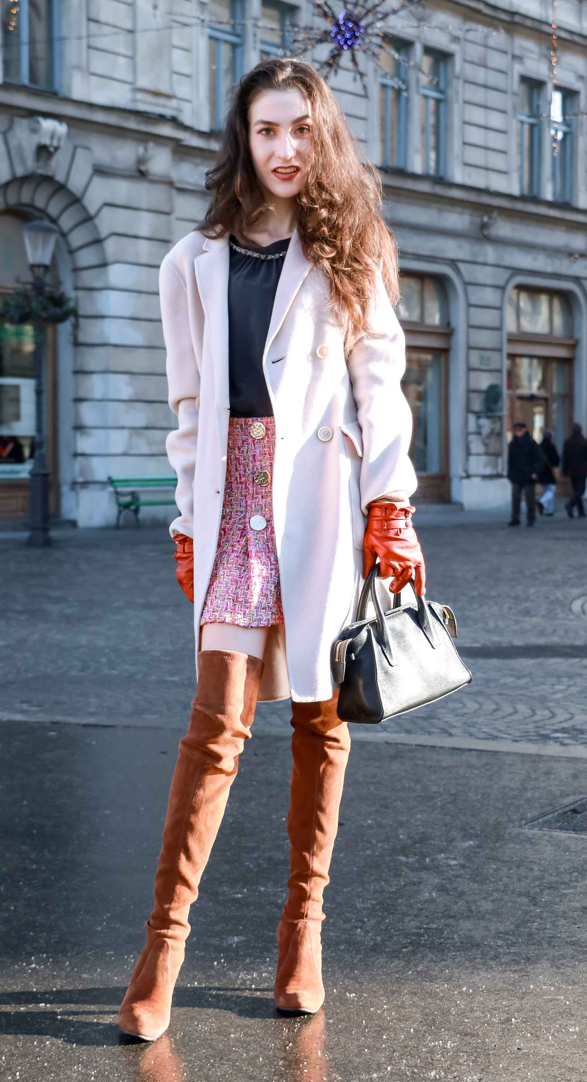 Fashion Blogger Veronika Lipar of Brunette from Wall Street wearing Storets pink tweed mini skirt, double breasted ivory coat from Weekend Maxmara, black silk blouse from Juicy couture, small black top handle bag, chestnut OTK boots from Stuart Weitzman this winter
