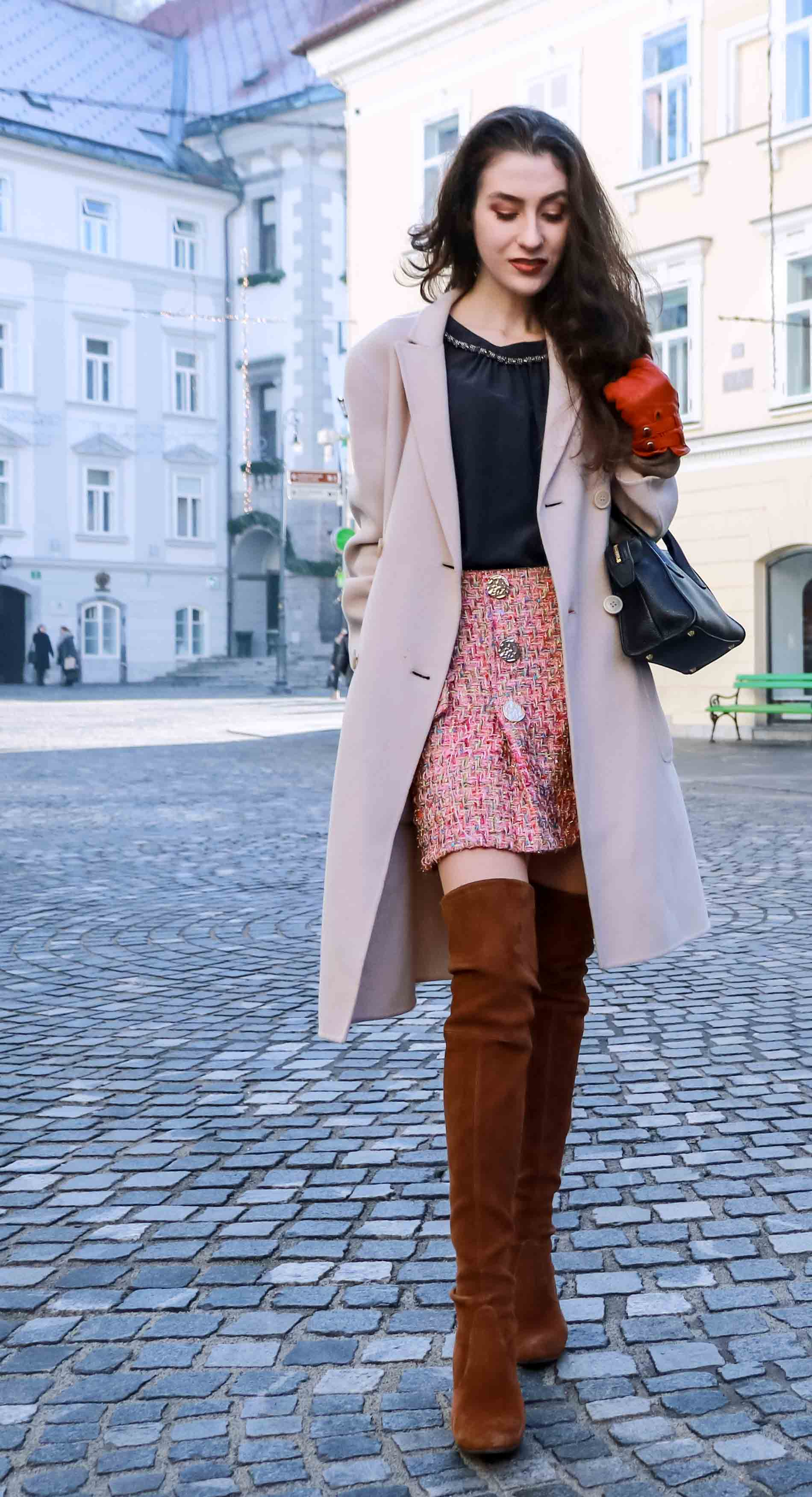 Fashion Blogger Veronika Lipar of Brunette from Wall Street wearing Storets pink tweed mini skirt, double breasted ivory coat from Weekend Maxmara, black silk blouse from Juicy couture, small black top handle bag, brown OTK boots from Stuart Weitzman this winter