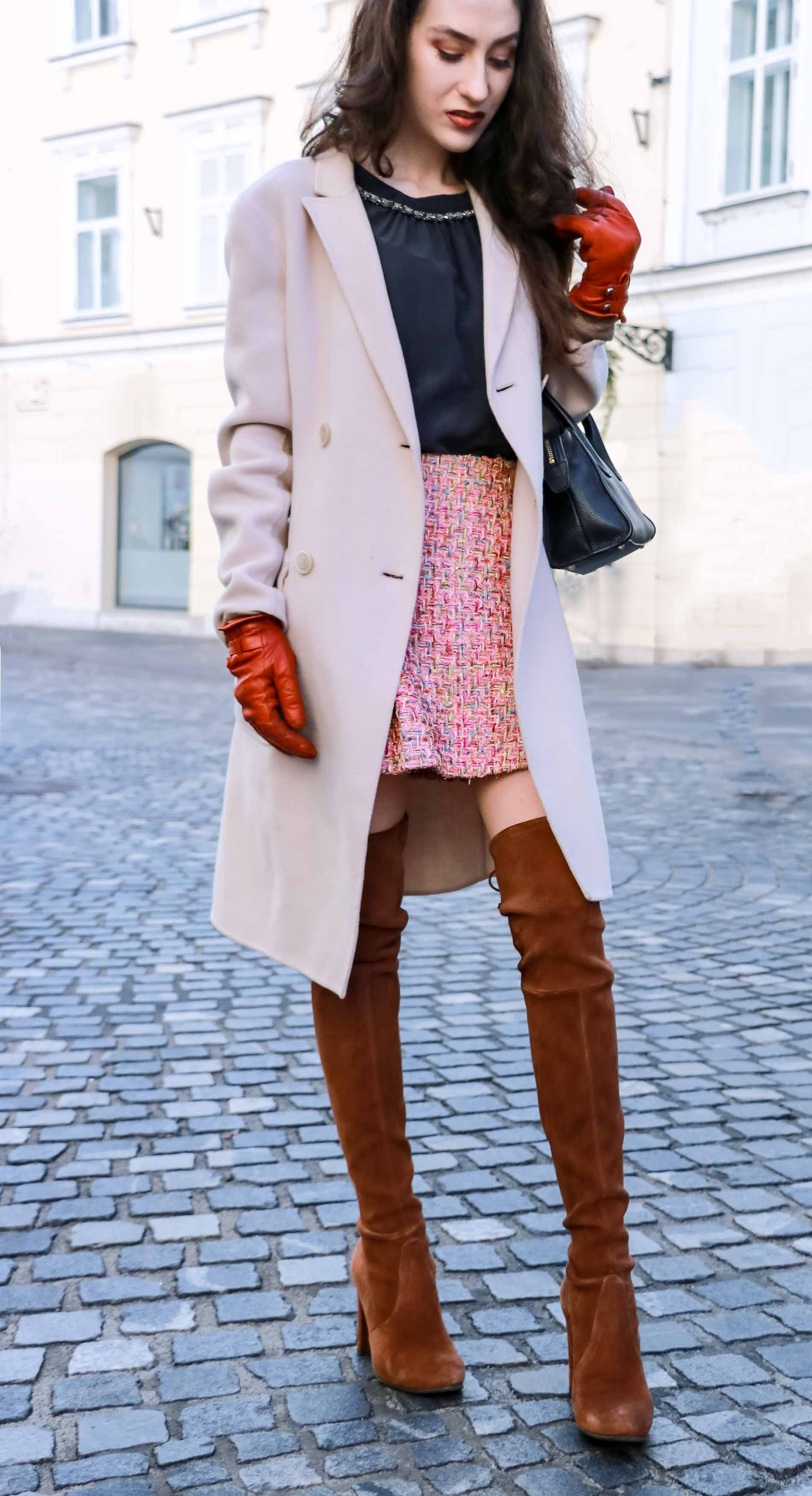 Fashion Blogger Veronika Lipar of Brunette from Wall Street wearing Storets pink tweed mini skirt, double breasted ivory coat from Weekend Maxmara, black silk blouse from Juicy couture, small black top handle bag, Stuart Weitzman chestnut OTK boots from this winter