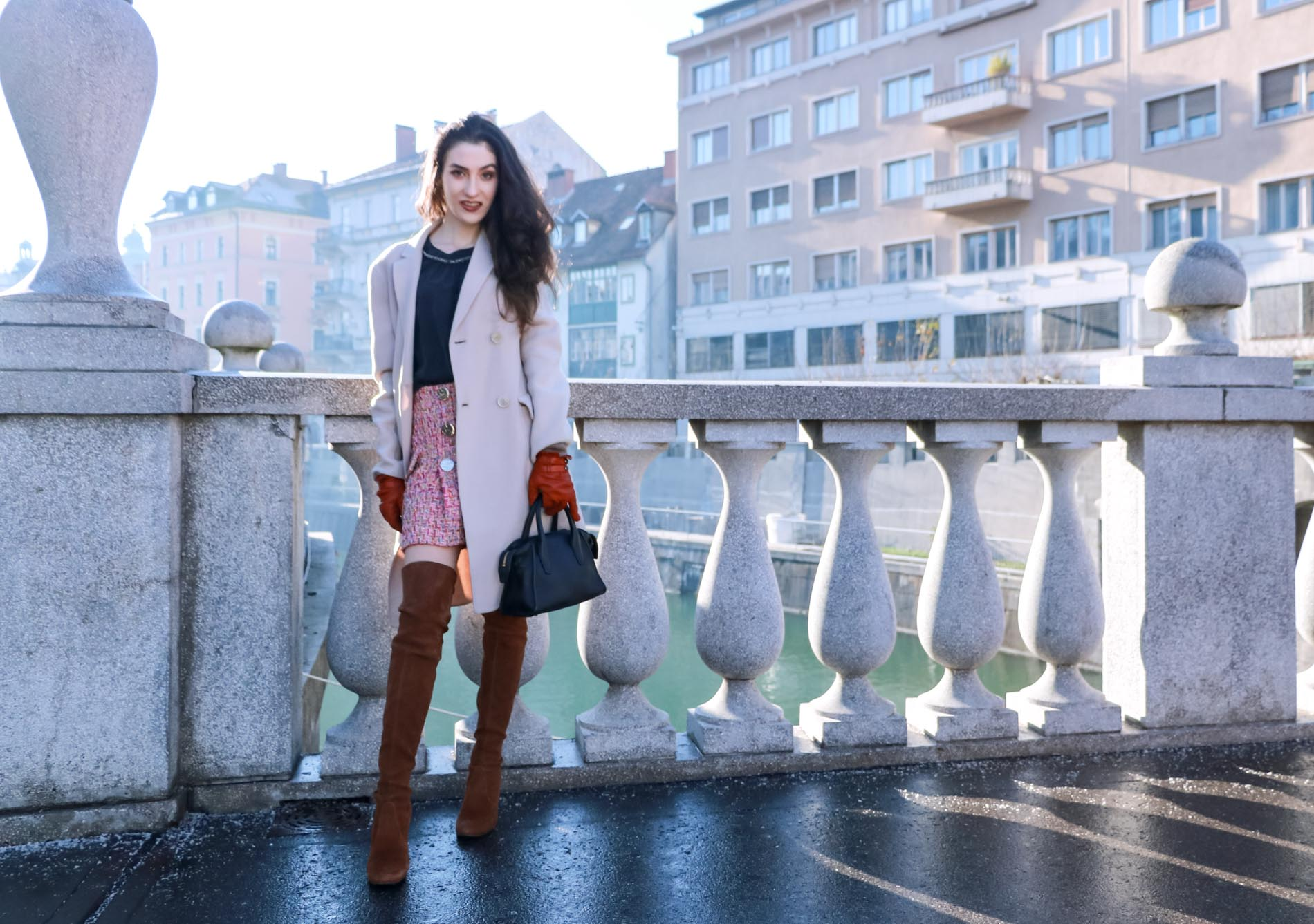 Fashion Blogger Veronika Lipar of Brunette from Wall Street wearing Storets pink tweed mini skirt, double breasted ivory coat from Weekend Maxmara, black silk blouse from Juicy couture, small black top handle bag, brown over the knee boots from Stuart Weitzman this winter in Ljubljana