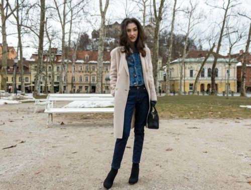 Fashion Blogger Veronika Lipar of Brunette from Wall Street wearing chic casual denim on denim trend, blue cropped denim jacket from H&M, with tapered straight-leg dark blue denim jeans from A.P.C., pastel pink, off-white double breasted Weekend Maxmara coat, black top handle bag, blue leather gloves and black sock ankle boots from Elena Iachi as mid-seasonal, traditional casual outfit