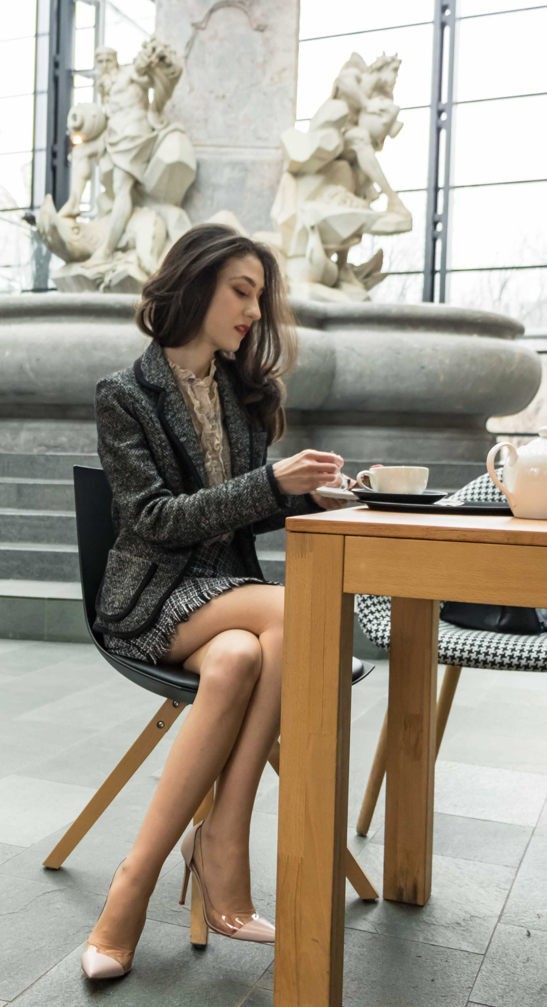 Fashion Blogger Veronika Lipar of Brunette from Wall Street wearing blush Gianvito Rossi Plexi 100 leather and PVC pump shoes, tweed plaid mini skirt from Storets, black and white Marella tweed jacket while having an afternoon tea